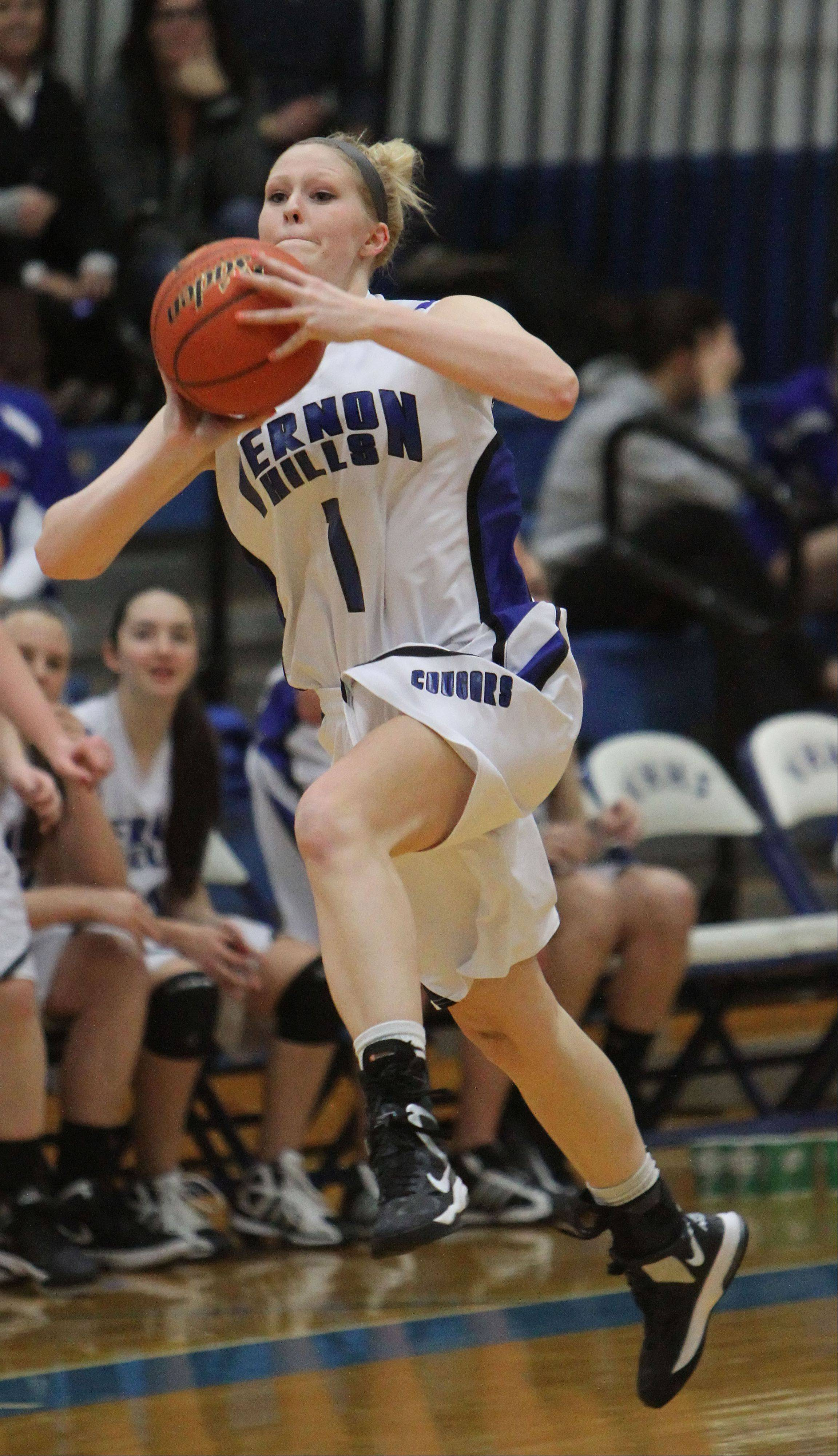 Vernon Hills' Sydney Smith launches a shot from halfcourt at the end of the first quarter against Stevenson on Tuesday.