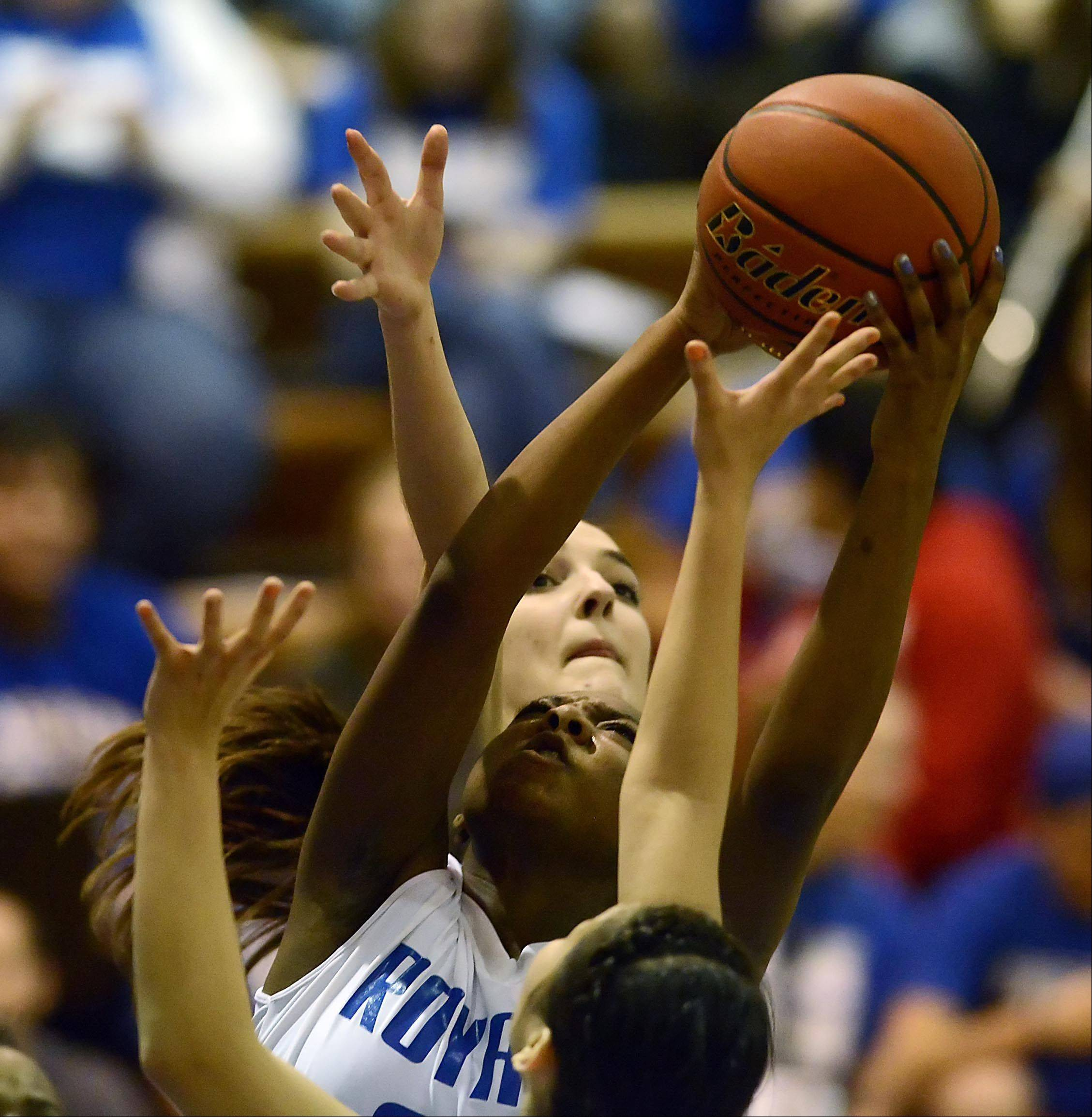 Larkin's Shawndrea Hill snags a rebound against Elgin's Tamara Milosevic.