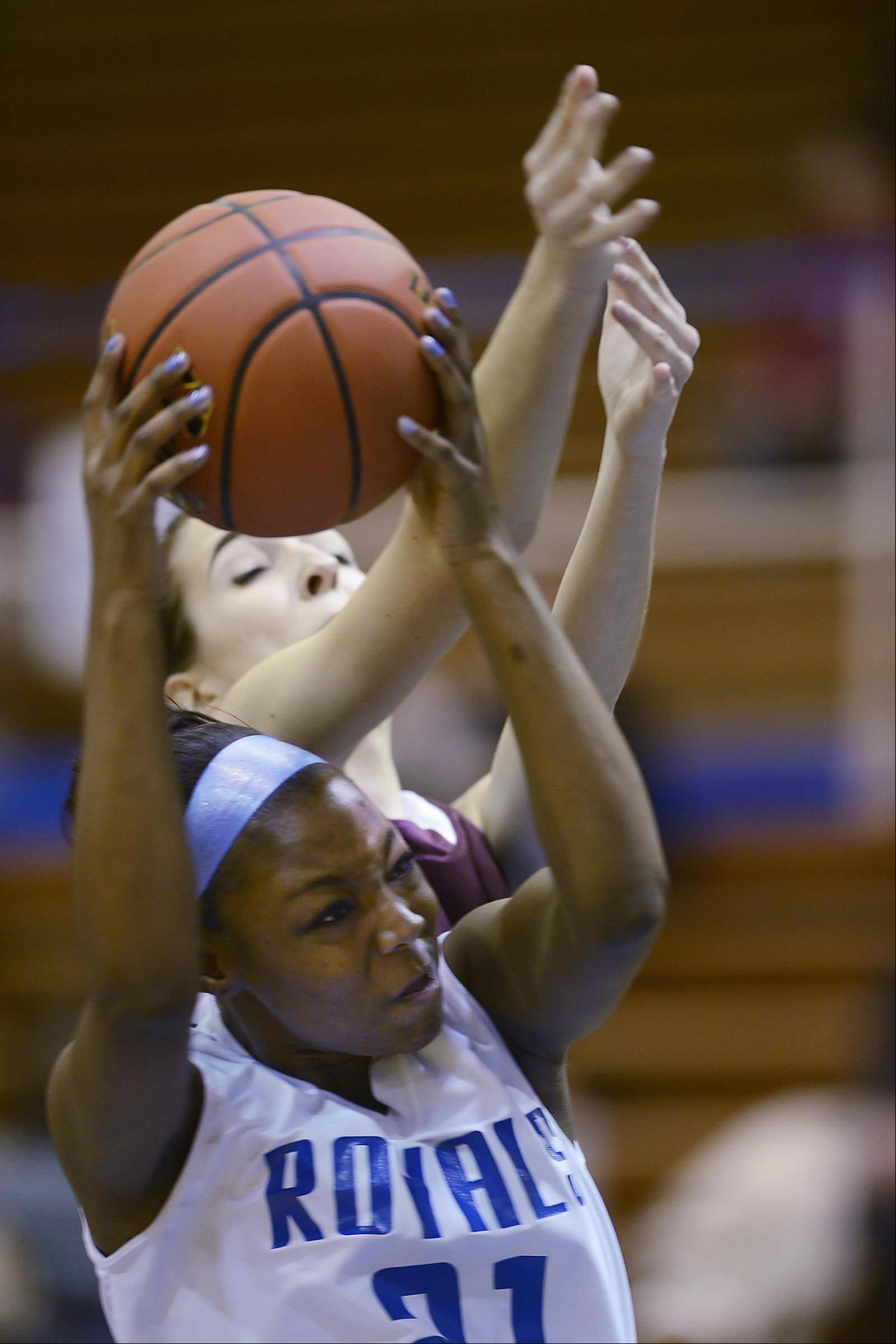 Larkin's Shawndrea Hill grabs a rebound against Elgin's Tamara Milosevic.
