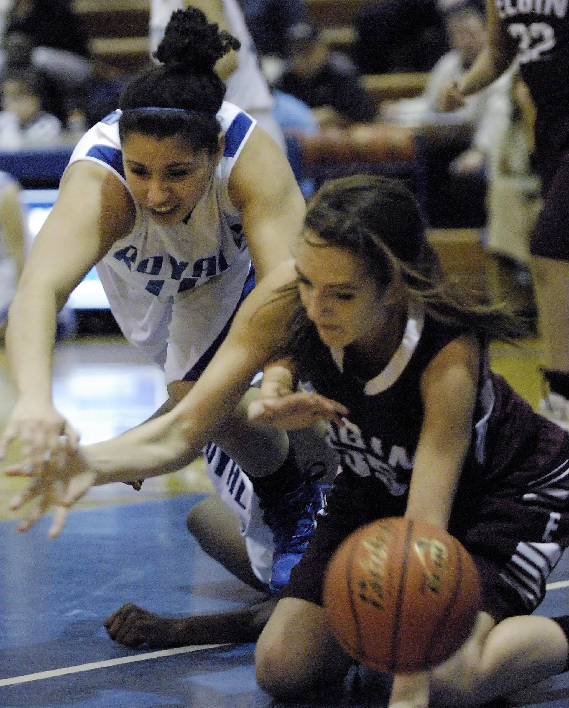 Elgin's Tamara Milosevic and Larkin's Amber McGhee, left, lose the ball out of bounds.