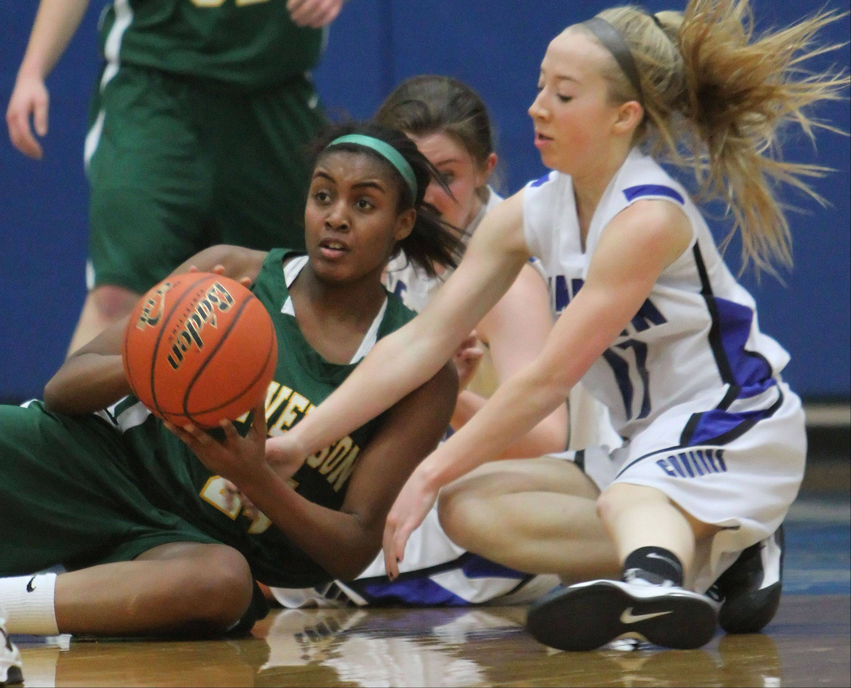 Stevenson's Taylor Buford, left, and Vernon Hills' Haley Lieberman scramble on the floor for a loose ball.