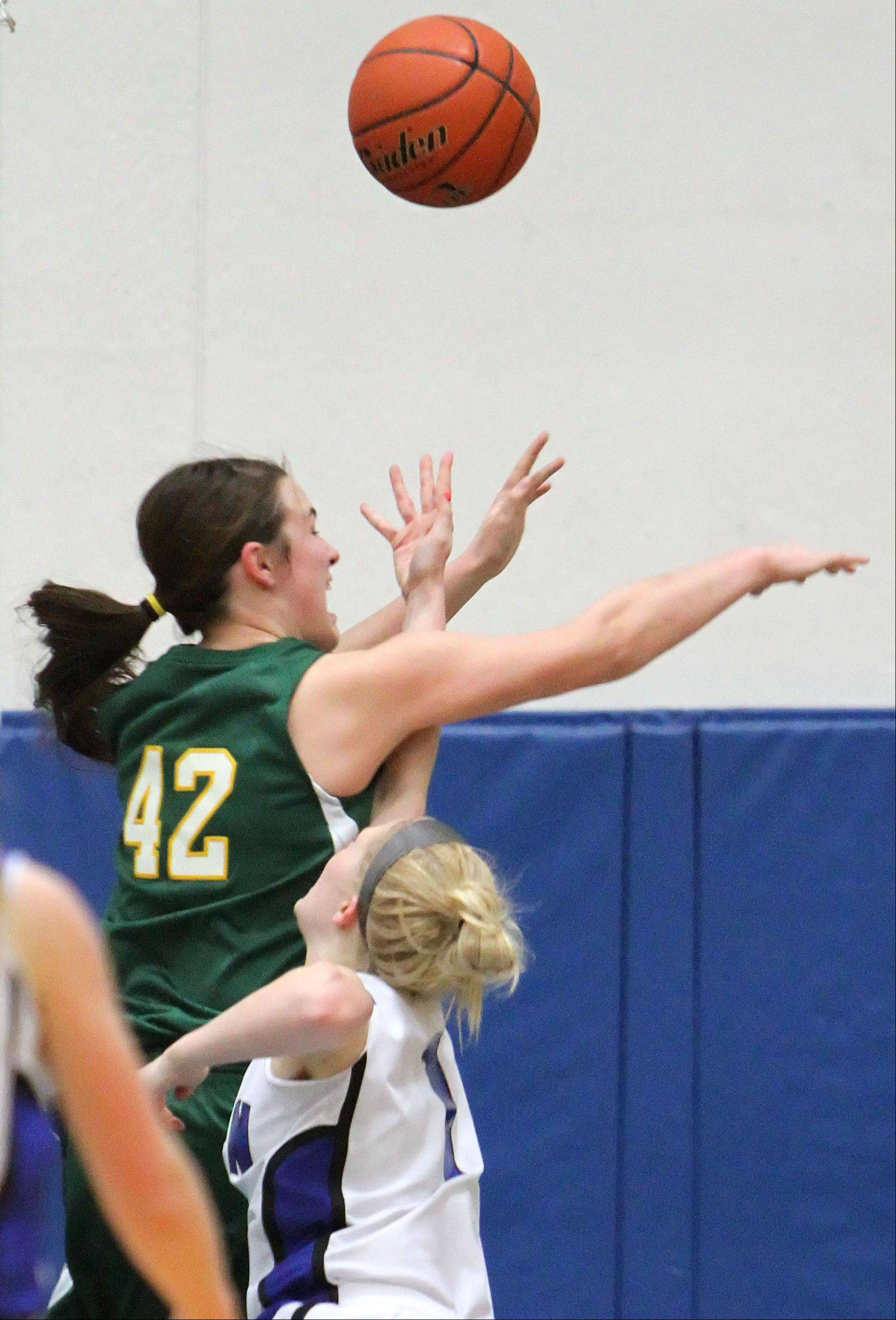 Vernon Hills' Sydney Smith, right, drives on Stevenson's Alex Elzinga.