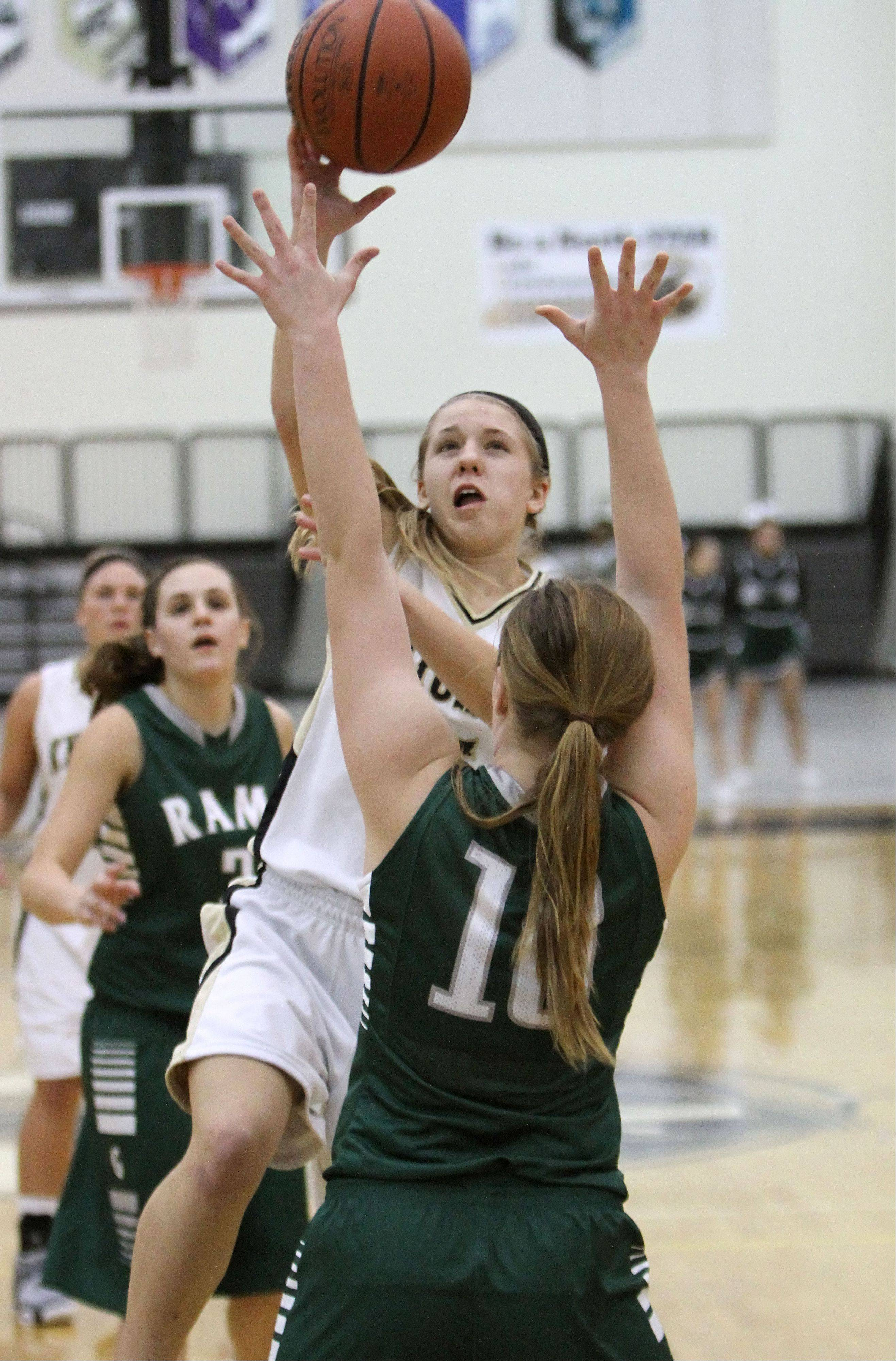 Grayslake North's Kendall Detweiler, left, drives on Grayslake Central's Maddy Miller during their game Wednesday night at Grayslake North High School.