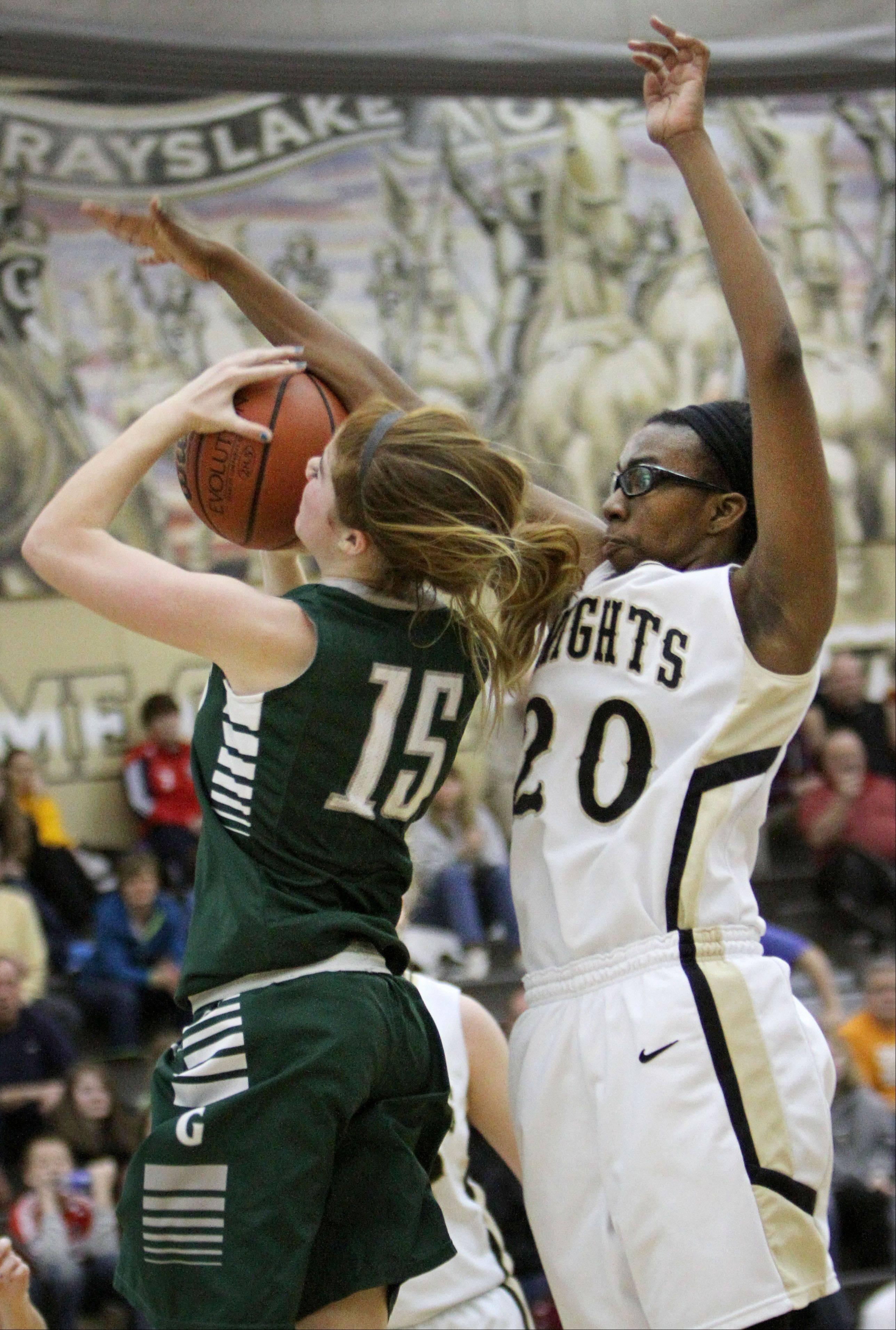 Grayslake Central's Lauren Spaulding, left, drives on Grayslake North's Brittany Thibeaux on Wednesday night at Grayslake North.