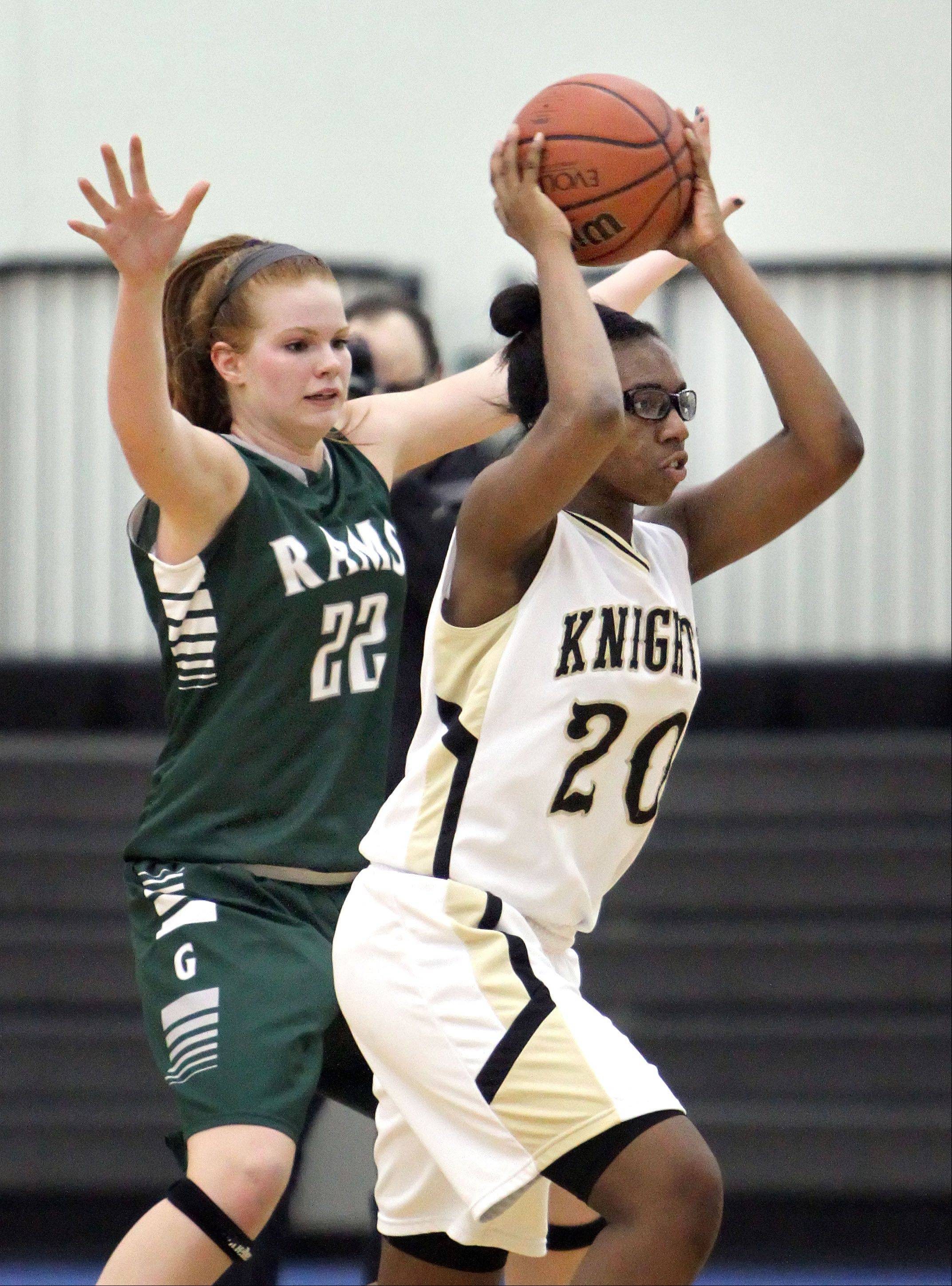 Grayslake North's Brittany Thibeaux, right, looks to pass with Grayslake Central's Morgan Dahlstrom defending Wednesday night at Grayslake North.