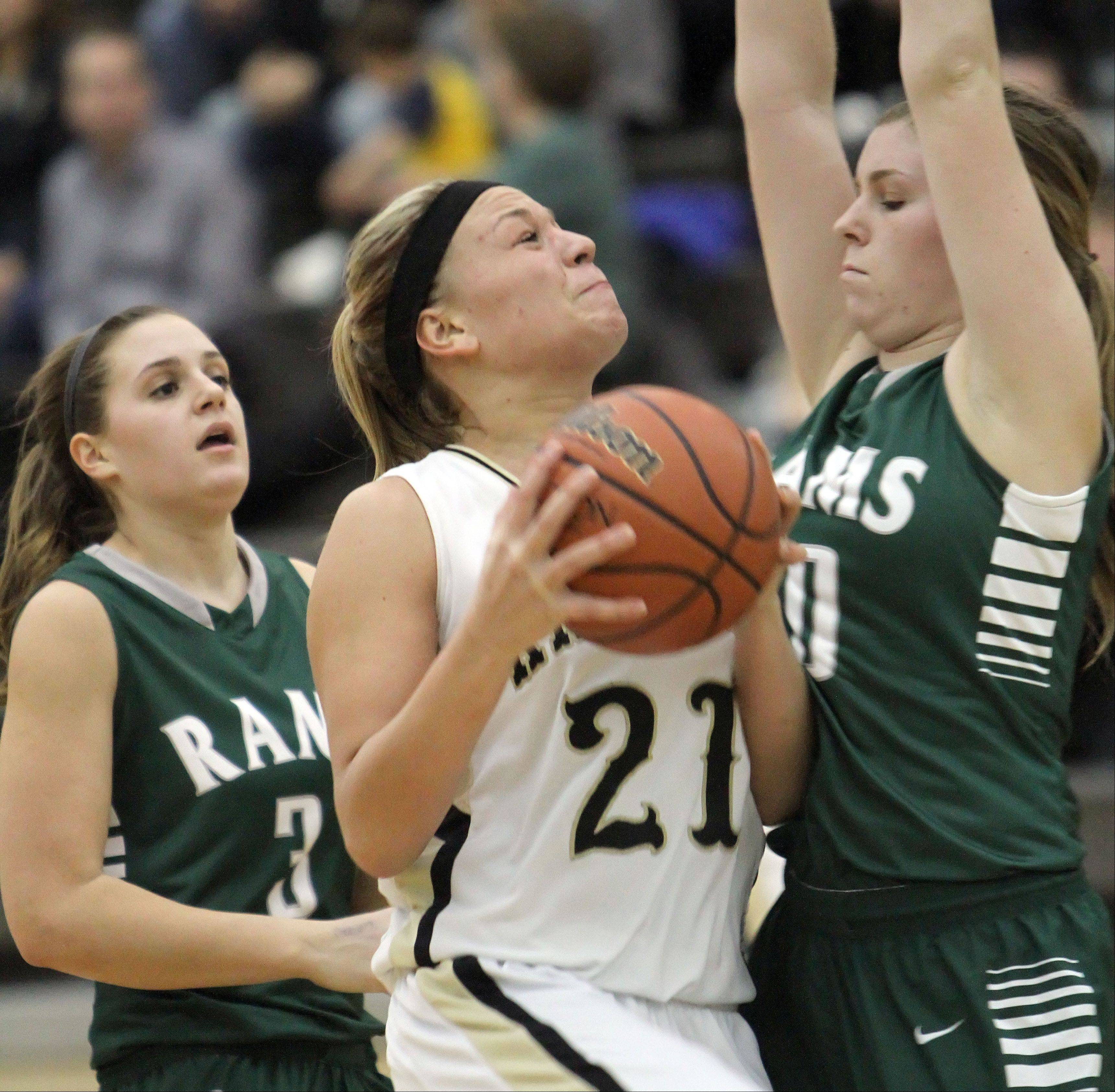 Grayslake North's Shyanne Ludwick, center, drives on Grayslake Central's Maddy Miller, right, and Savannah Mudd on Wednesday night at Grayslake North.