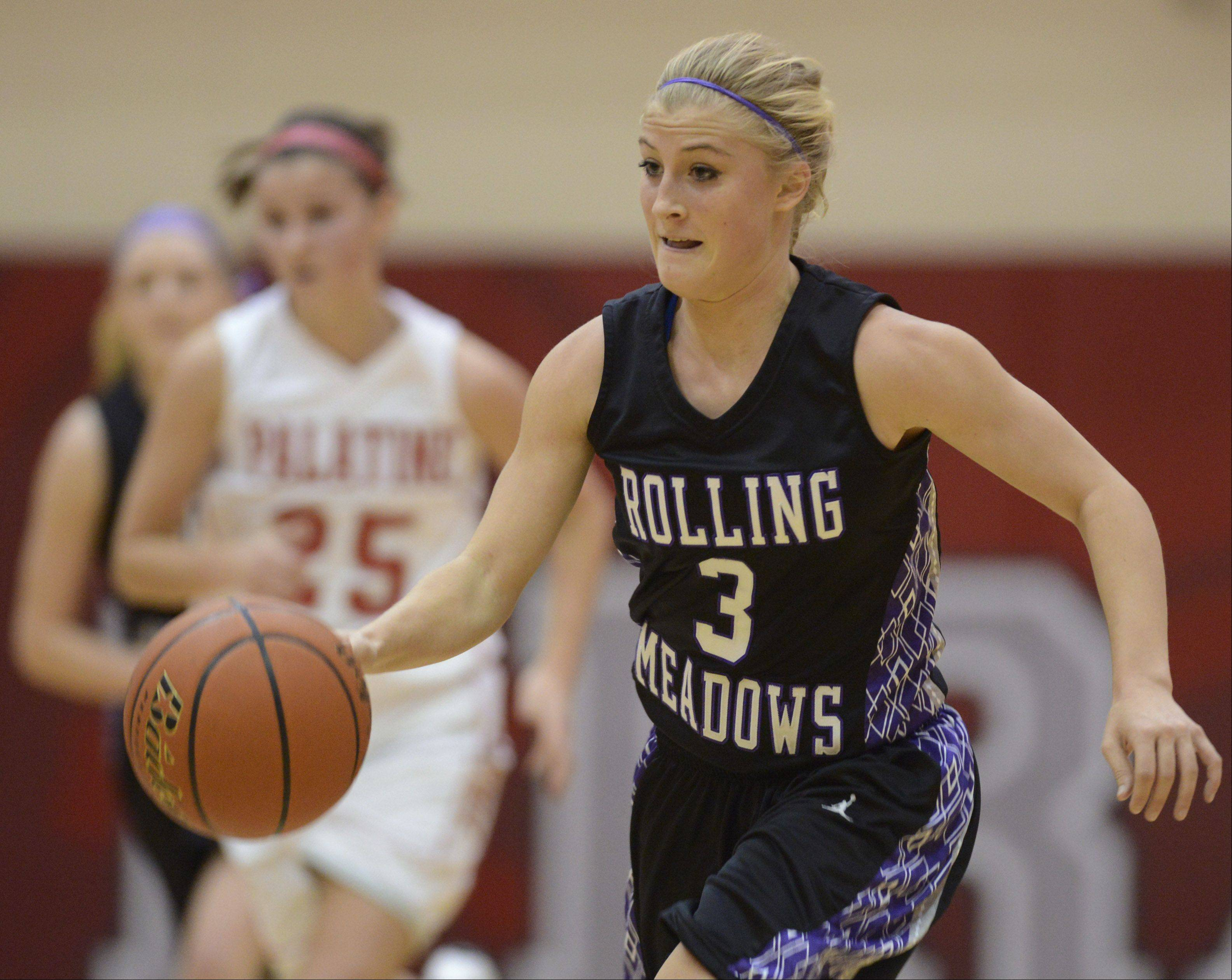 Rolling Meadows' Jackie Kemph leads a fast break against Palatine.