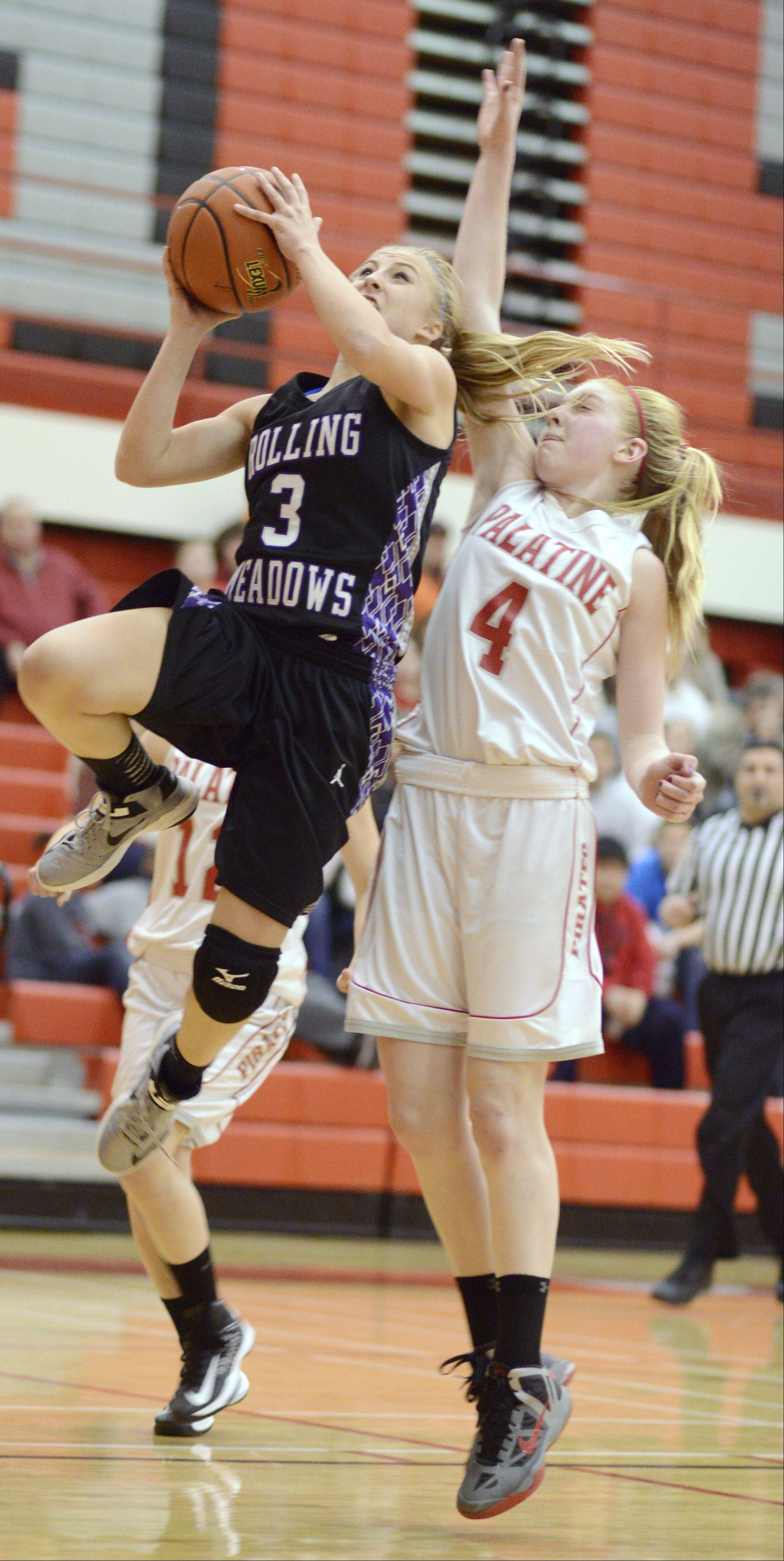 Rolling Meadows' Jackie Kemph stays a step ahead of Palatine's Morgan Radtke on a fast break.