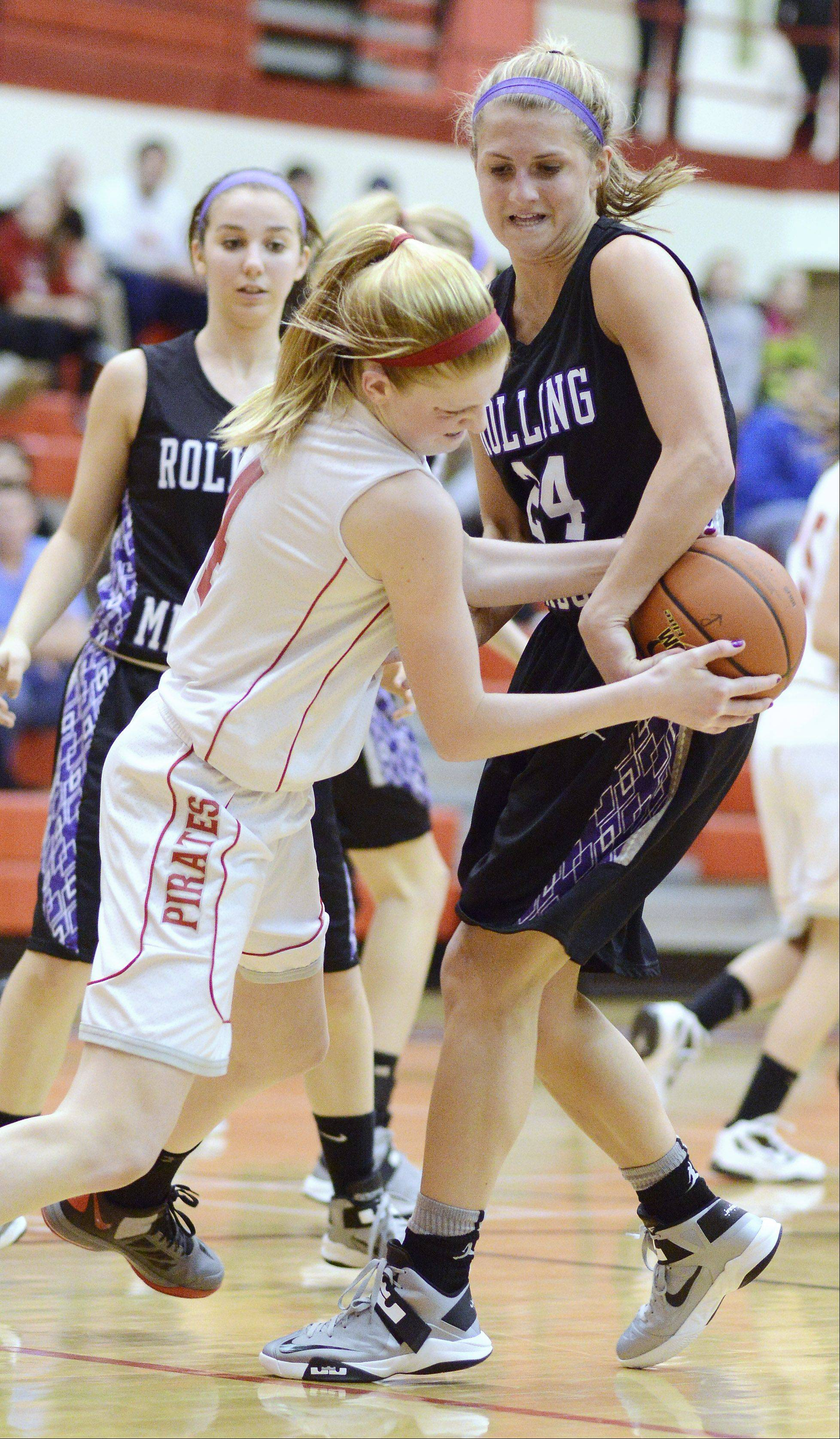 Palatine's Morgan Radtke, left, is fouled by Rolling Meadows defender Alexis Glasgow.