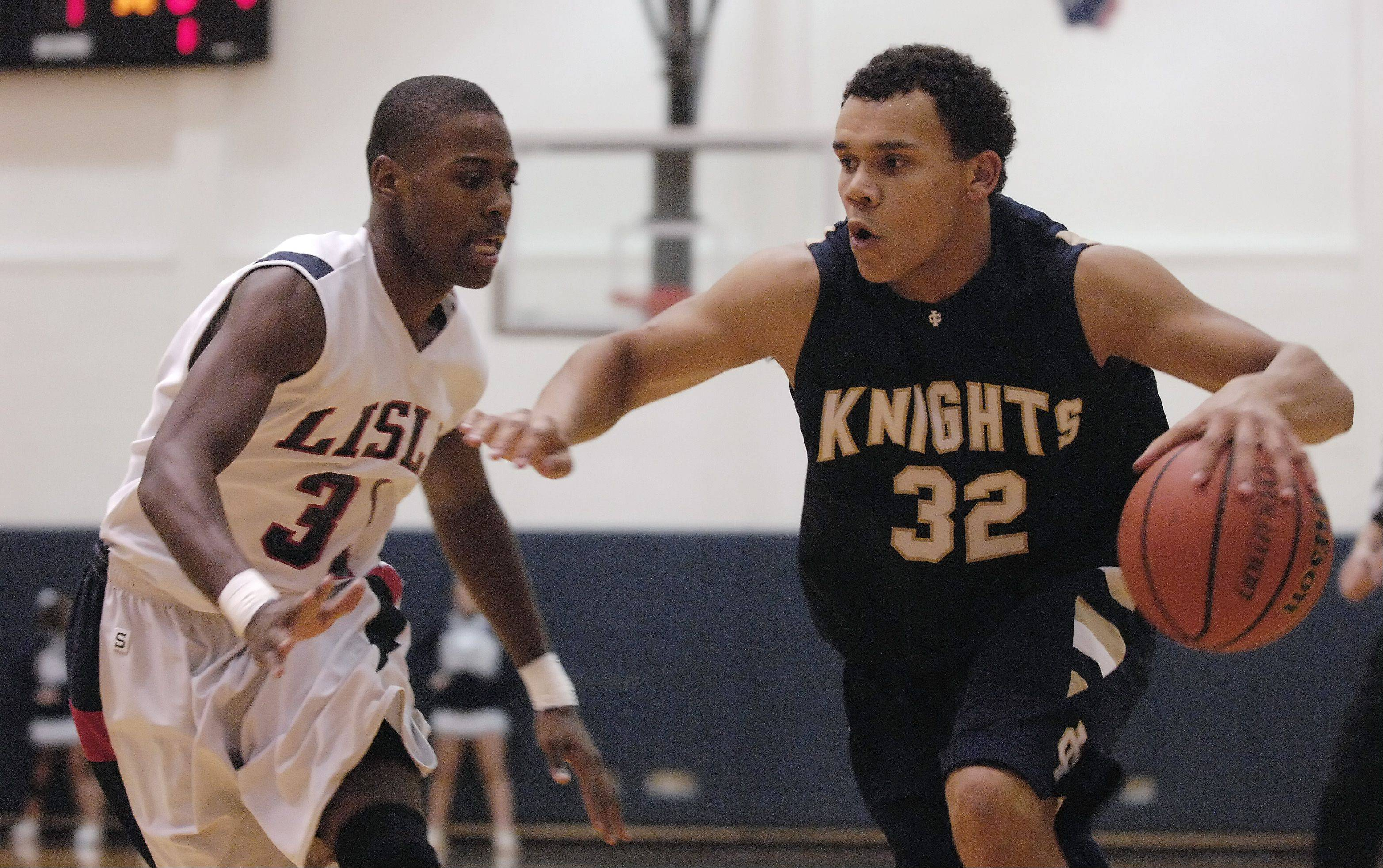 Lamont Ross of Lisle High School guards Demetrius Carr of Immaculate Conception High School.