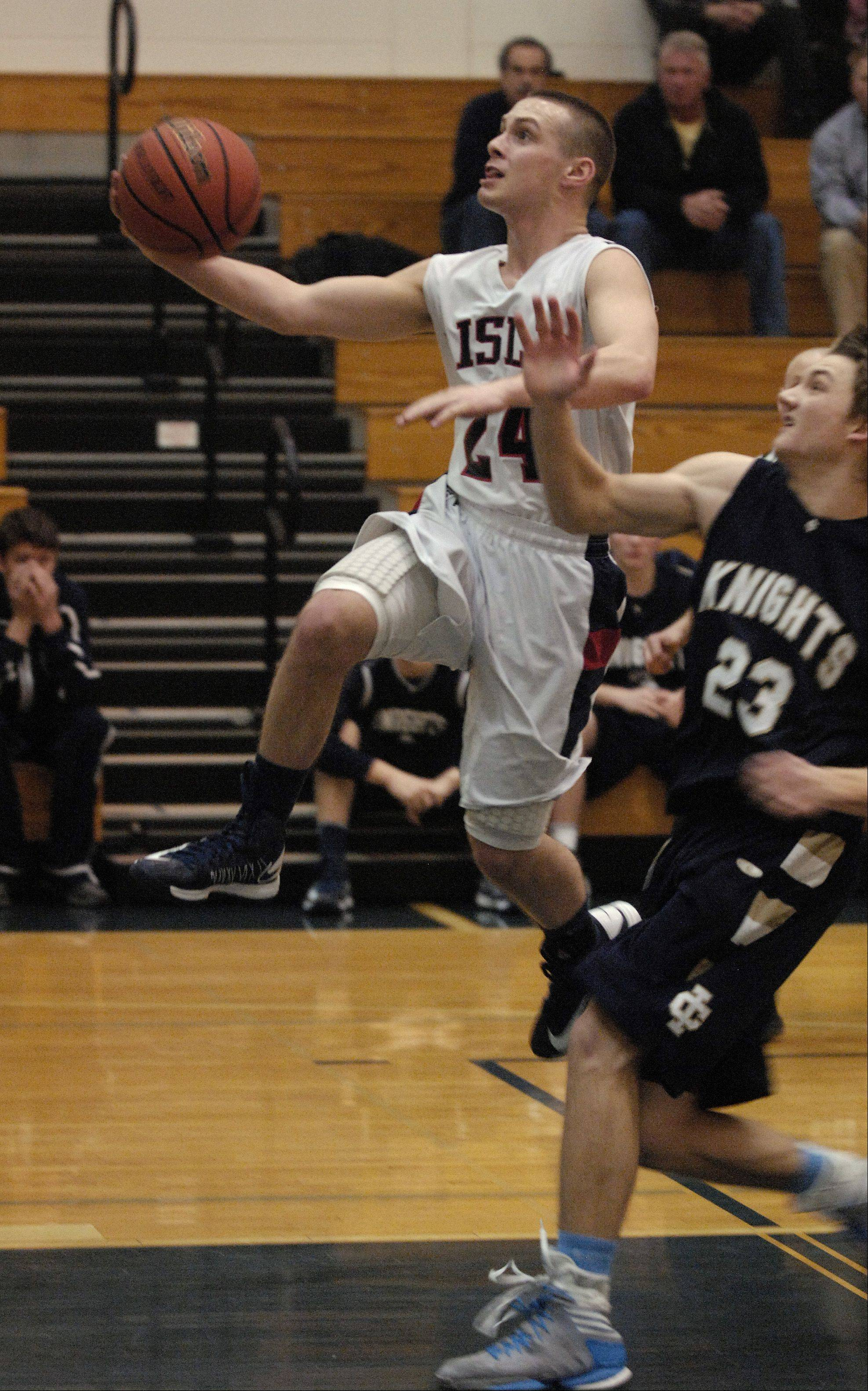 Cody Monson of Lisle High School gets past Clark Brinkman of Immaculate Conception High School.