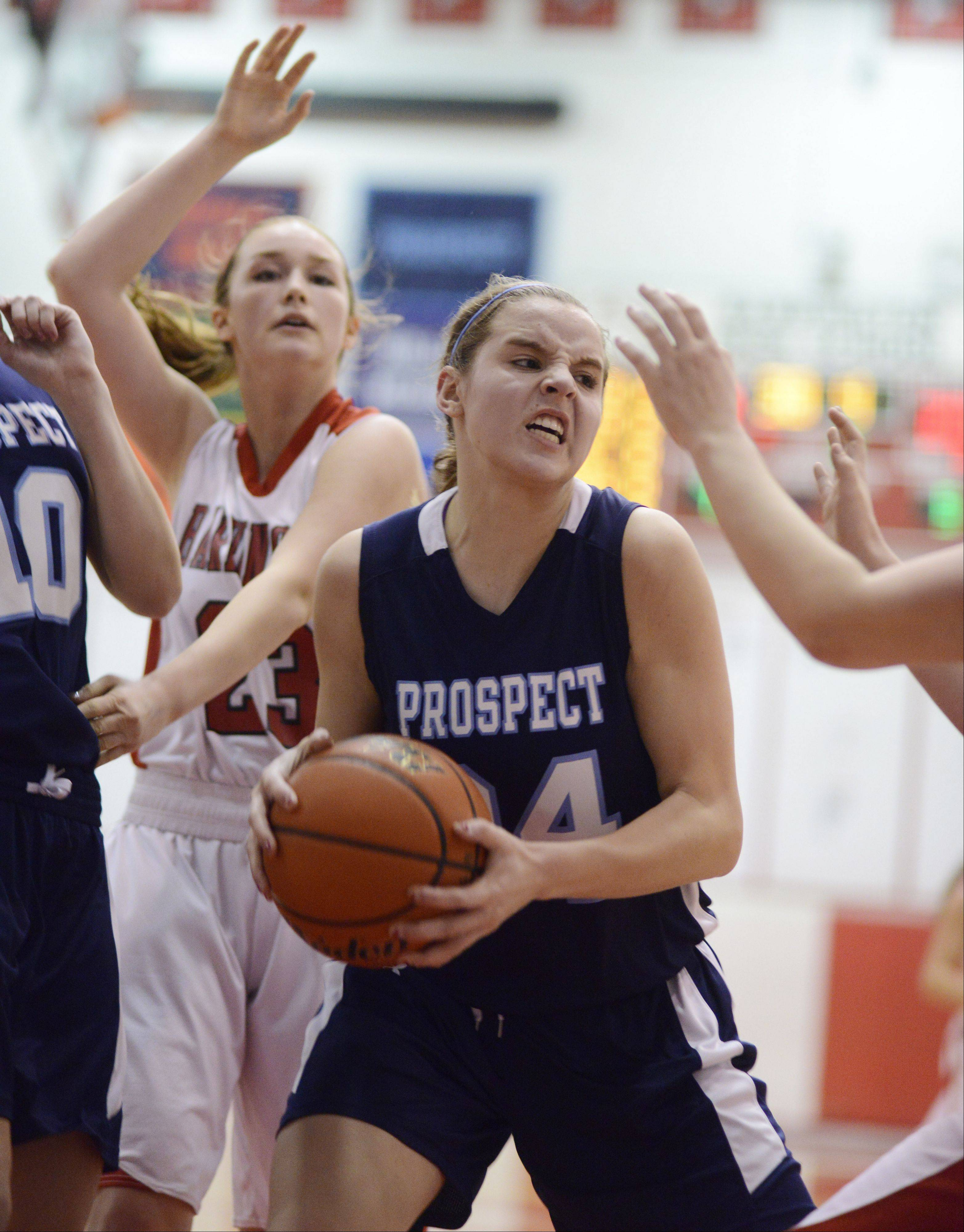 Prospect's Catherine Sherwood grabs a rebound between Barrington players including Brooke Gunderson, left.