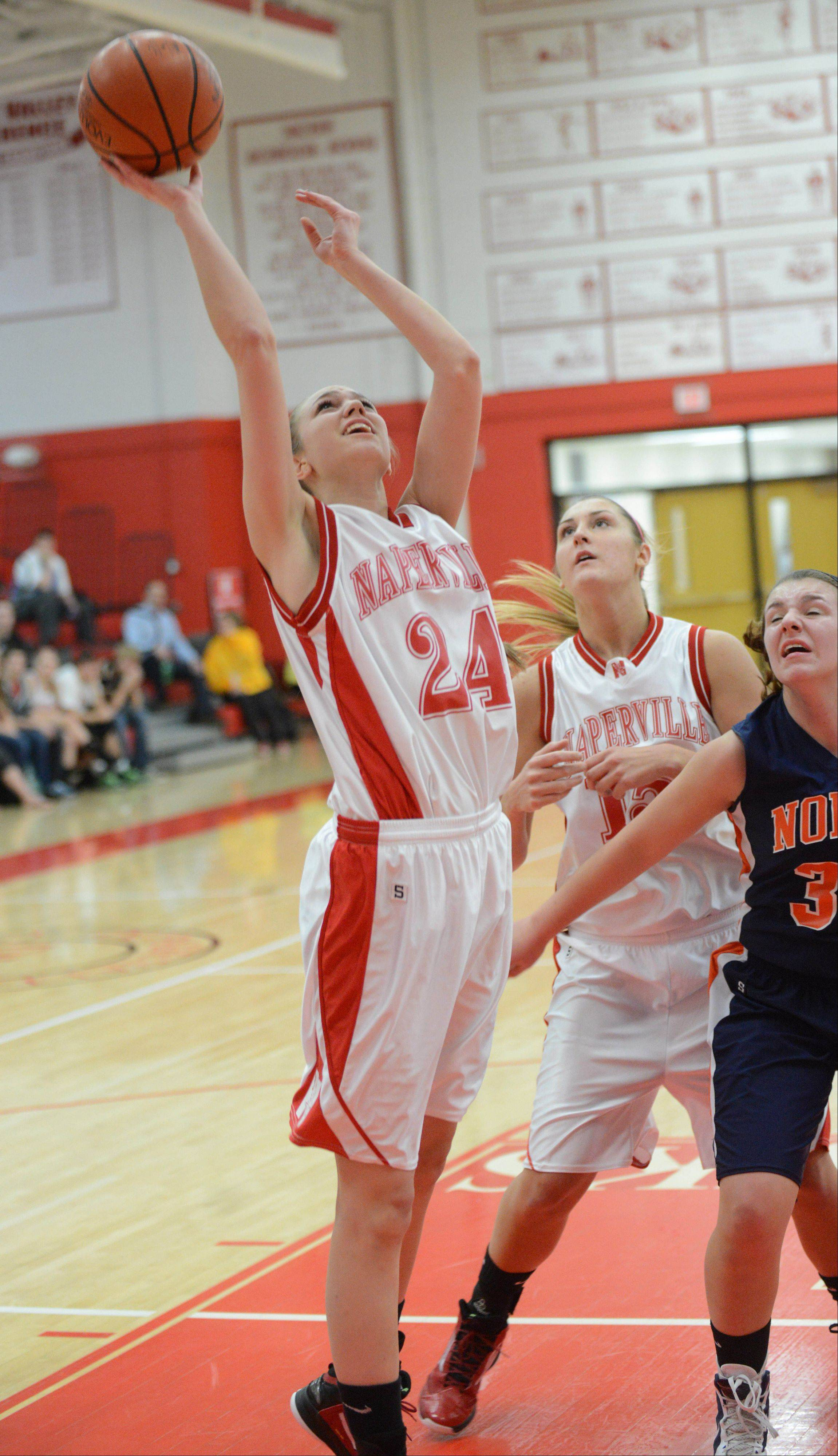 Jamie Cuny of Naperville Central takes a shot during the Naperville North at Naperville Central girls basketball game Thursday.