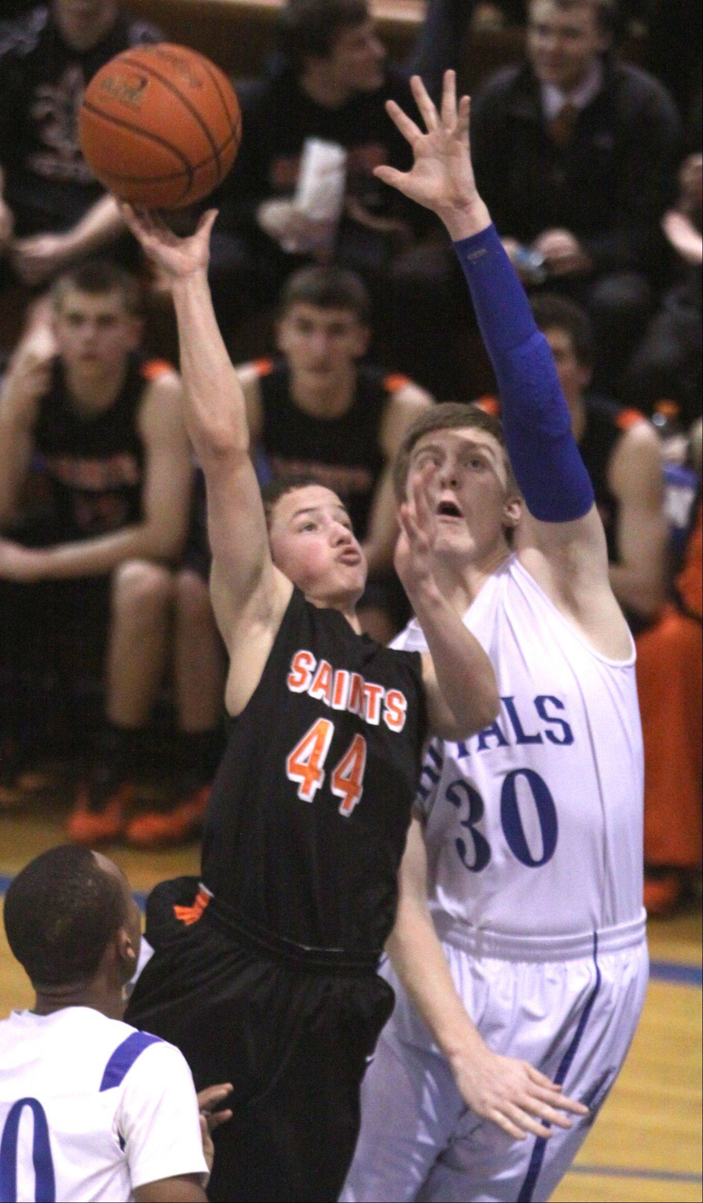 Larkin's Brayden Royse, right, tries to block St. Charles East's Cole Gentry during a varsity game in Elgin on Thursday night.