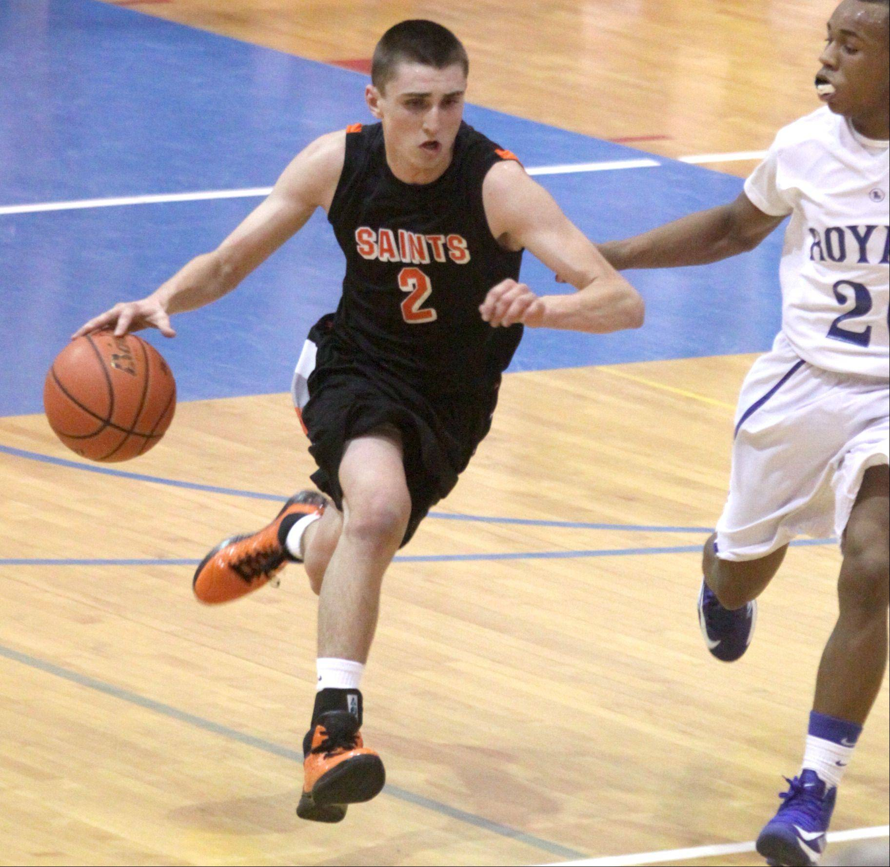 St. Charles East's Dom Adduci moves the ball during a varsity game at Larkin on Thursday night.