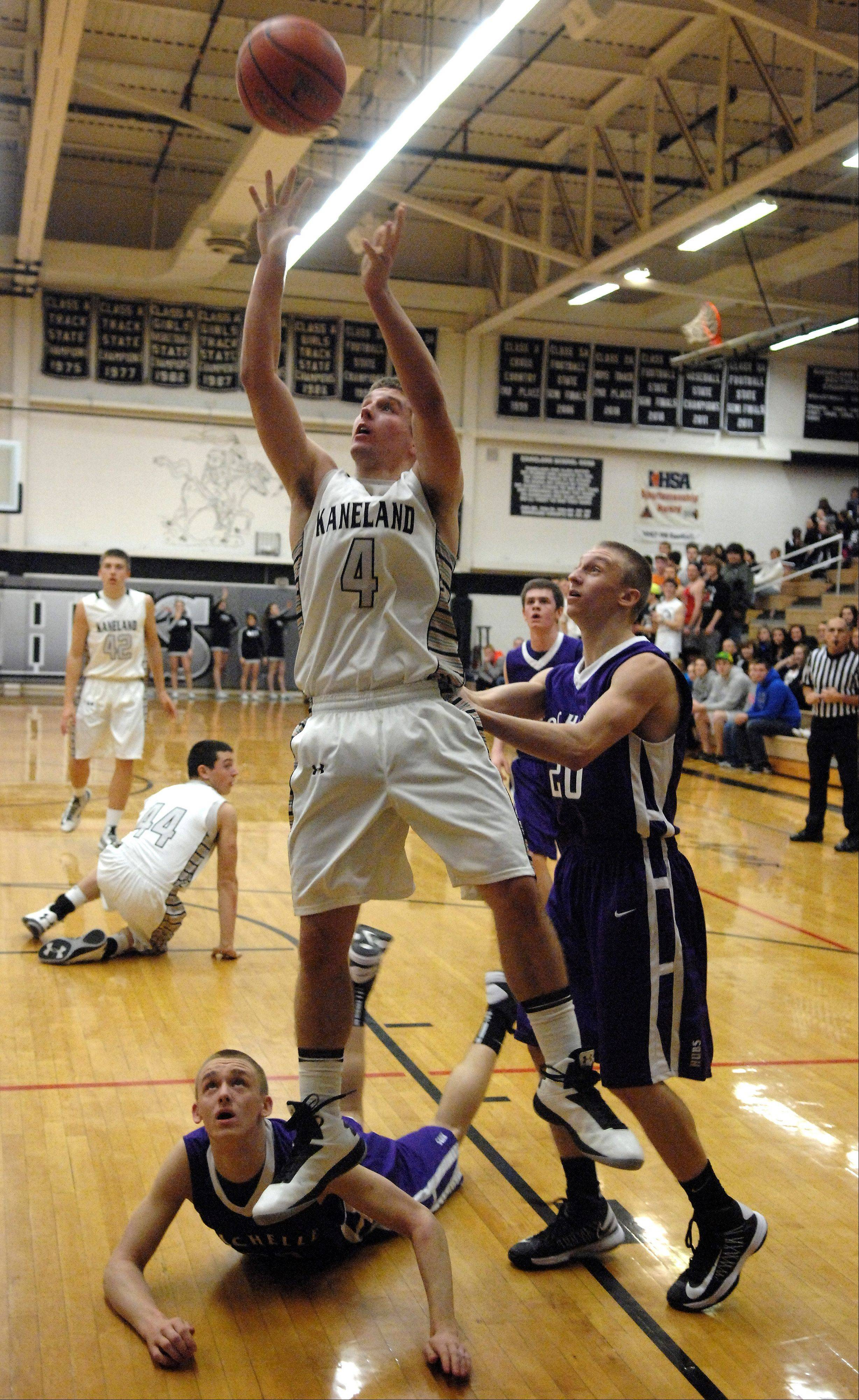 Kaneland's Drew David puts up a shot after a scramble on the floor for the ball.