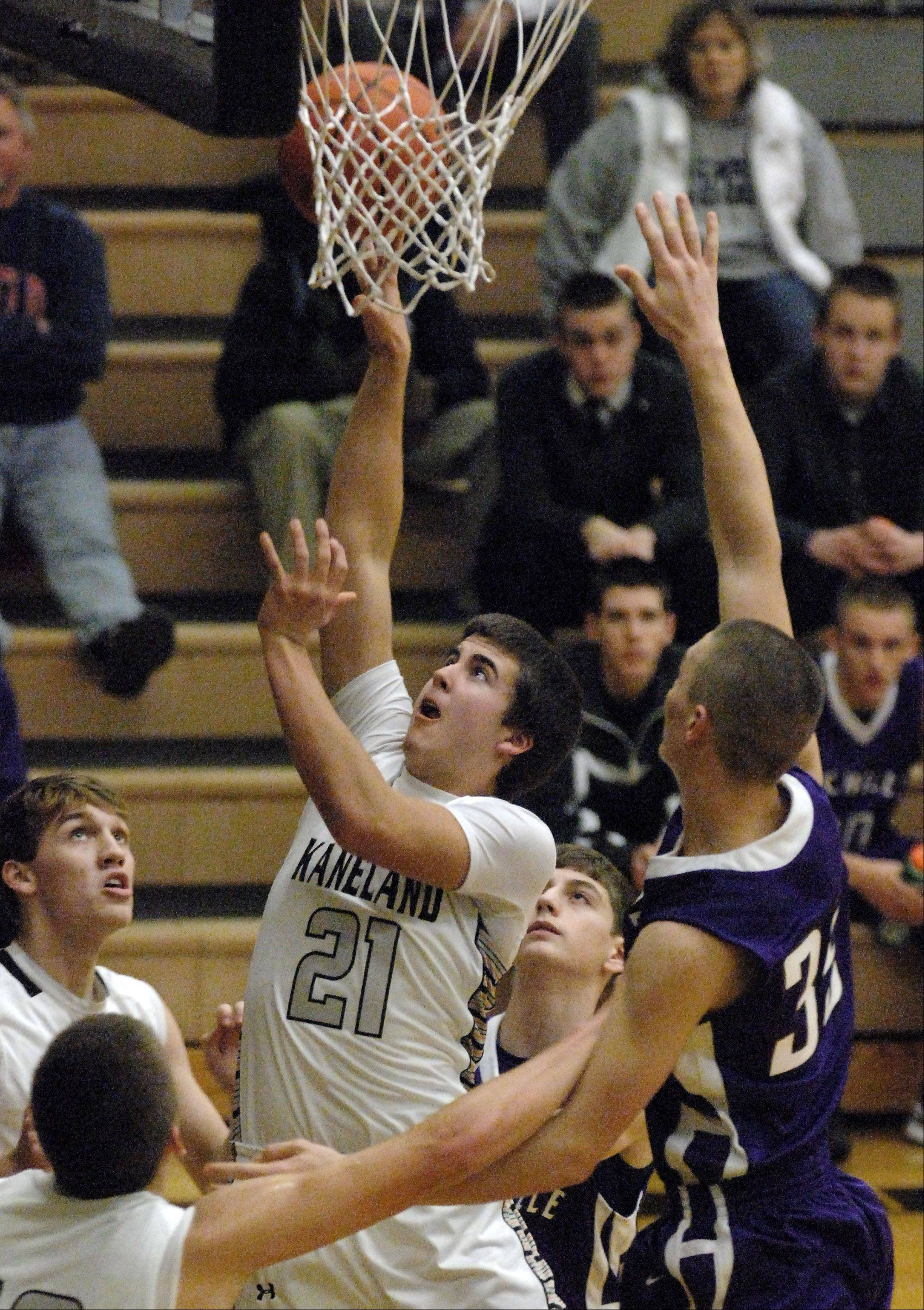 Kaneland's Tom Van Bogaert puts up a shot in the lane against Rochelle.