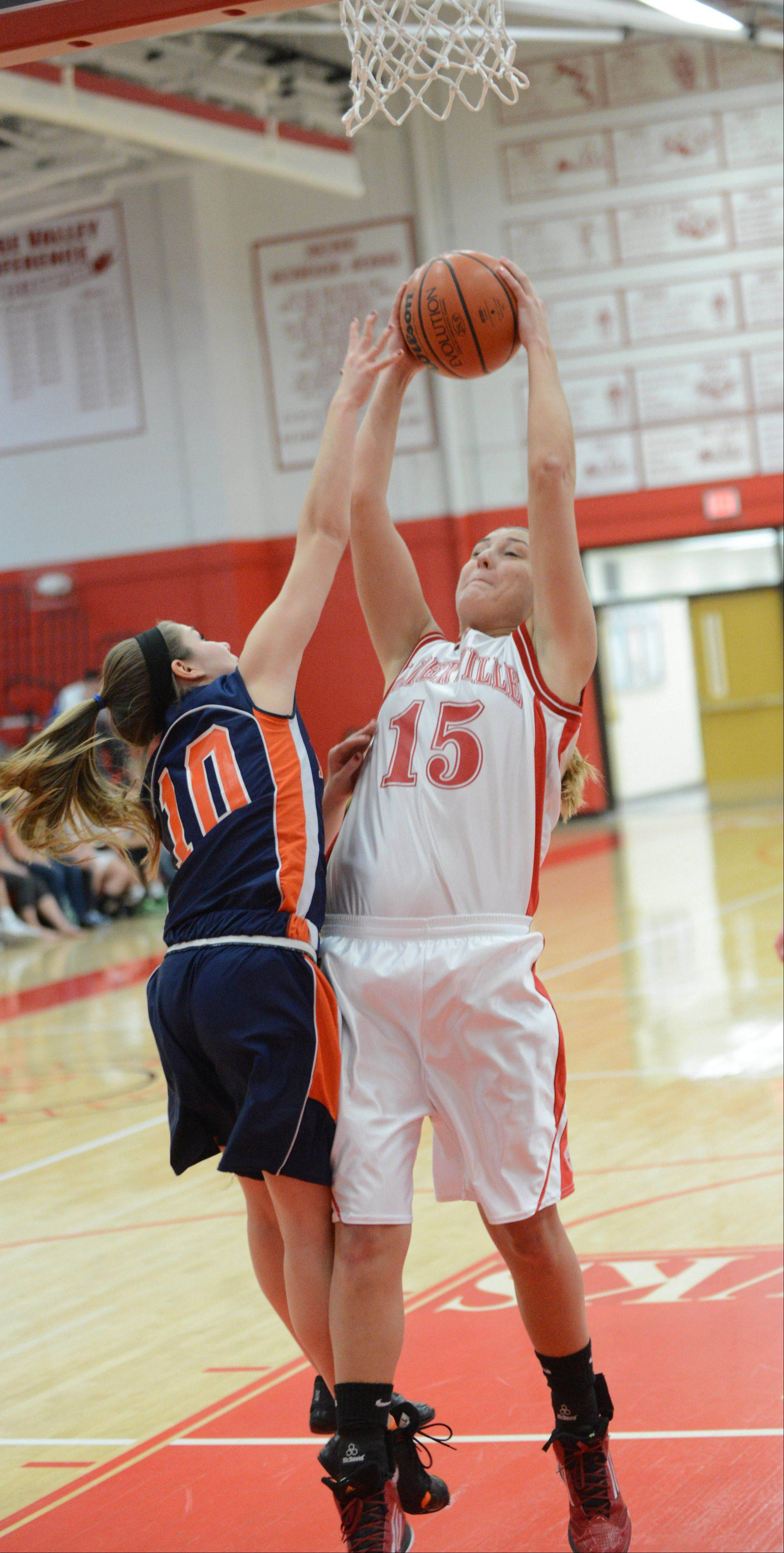 Lauren LoLordo of Naperville North tries to block Victoria Trowbridge of Naperville Central.