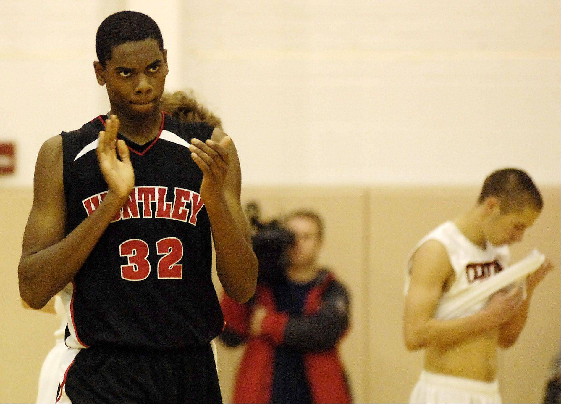 Huntley's Amanze Egekeze, shown here during the championship game of the 2011 Jacobs Holiday Tournament, has returned to action from injury for the Red Raiders.