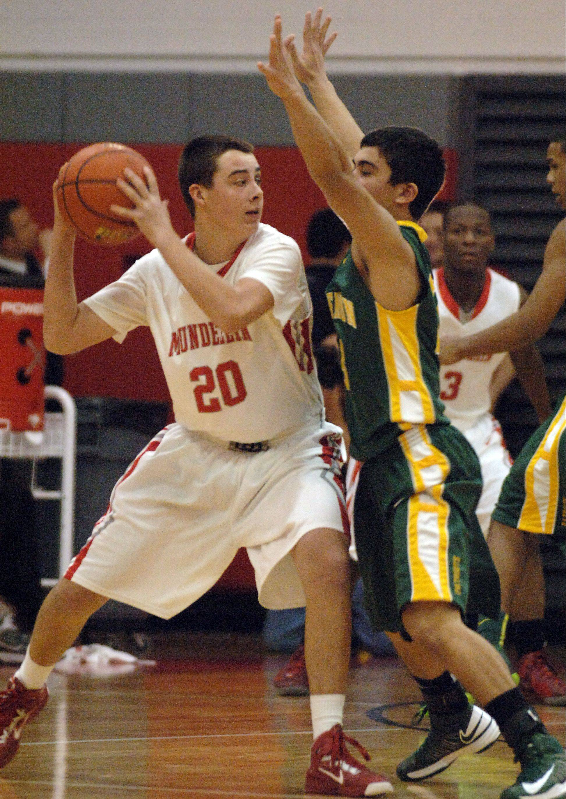 Mundelein's Derek Parola, left, looks to pass around Stevenson's Justin Berkson on Friday in Mundelein.