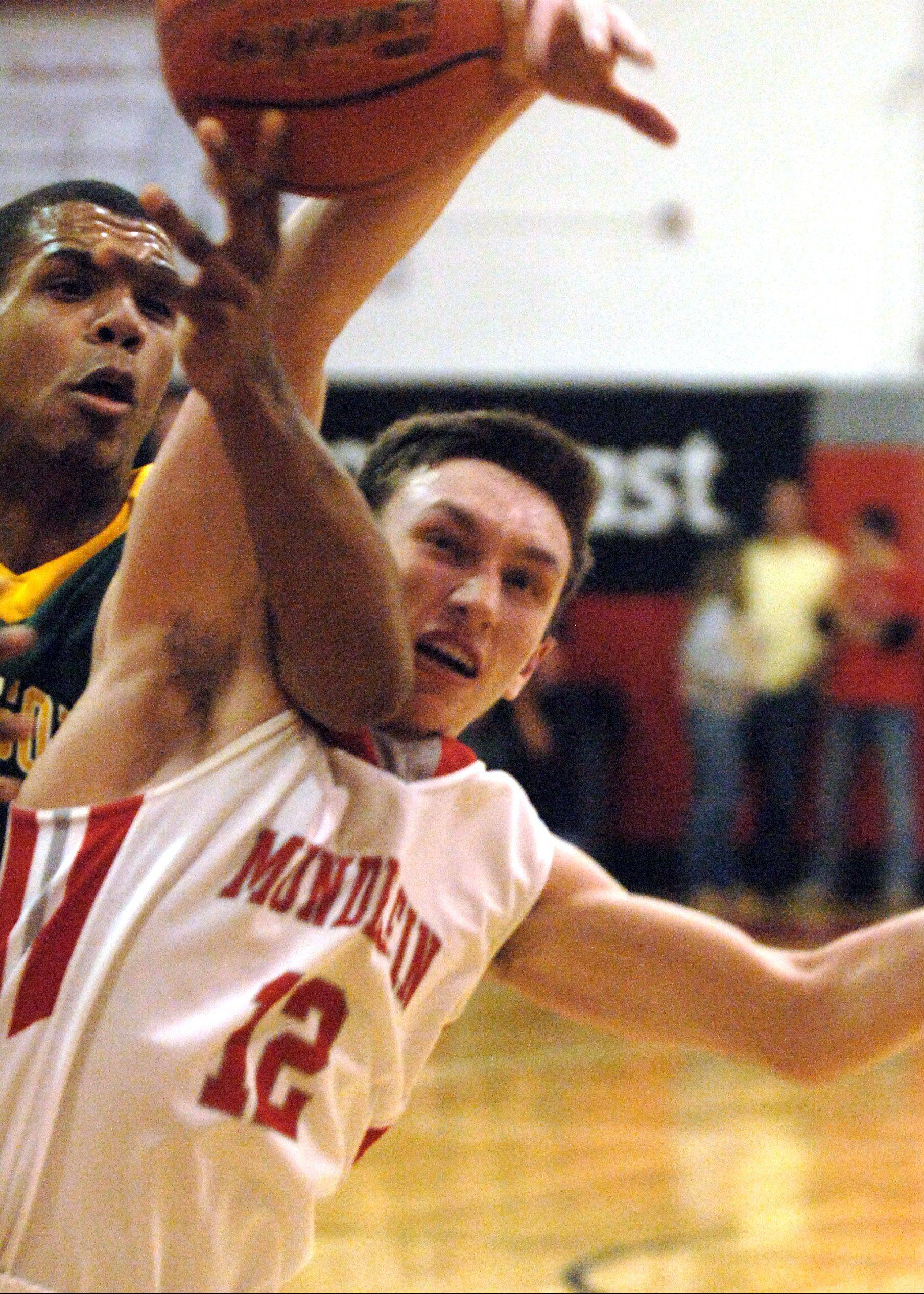 Stevenson's Connor Cashaw, left, and Mundelein's Quinn Pokora fight for a rebound Friday night in Mundelein.