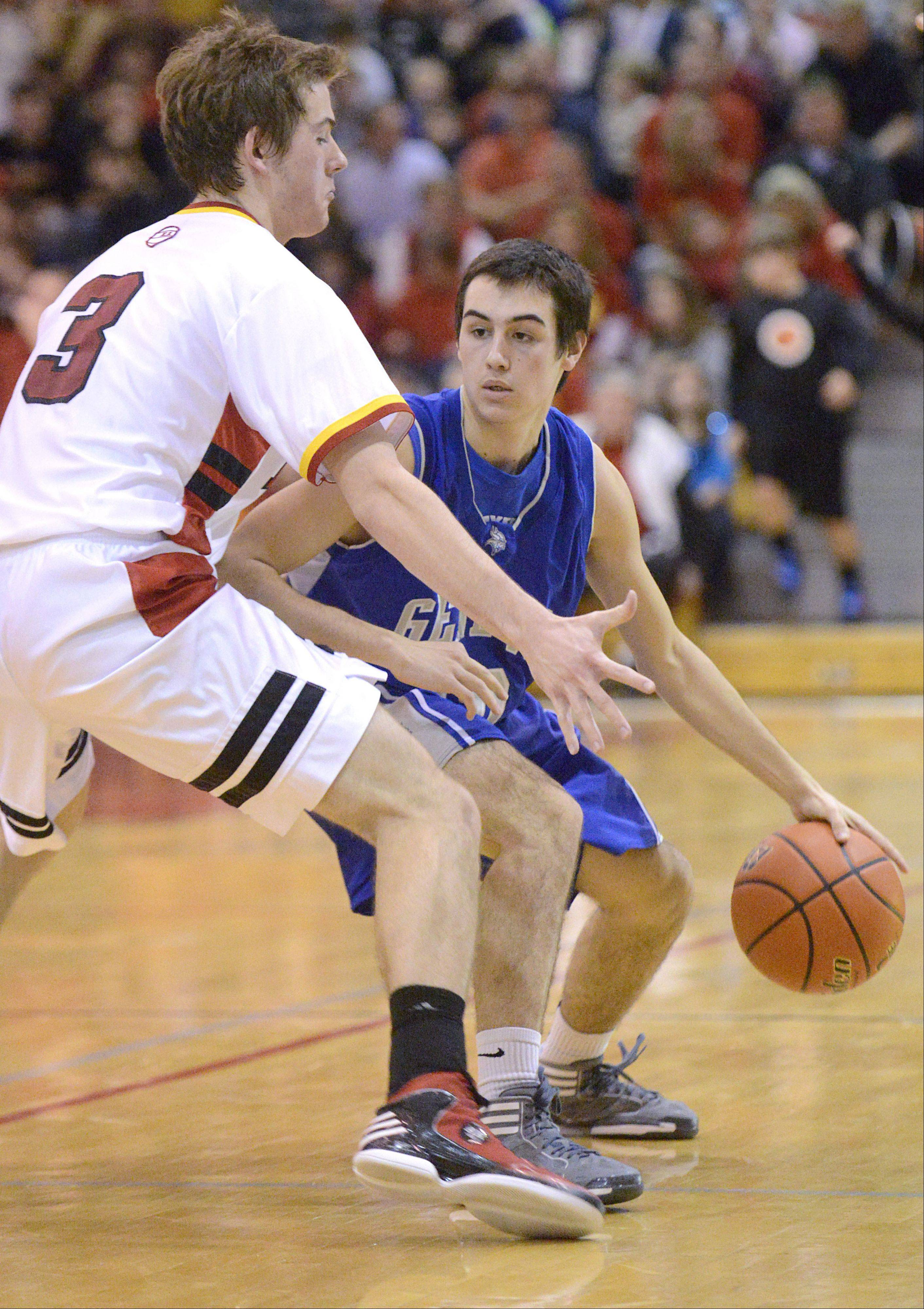 Geneva's Pat McCaffrey maneuvers his way around a block by Batavia's Jake Pollack in the fourth quarter on Friday, January 11.