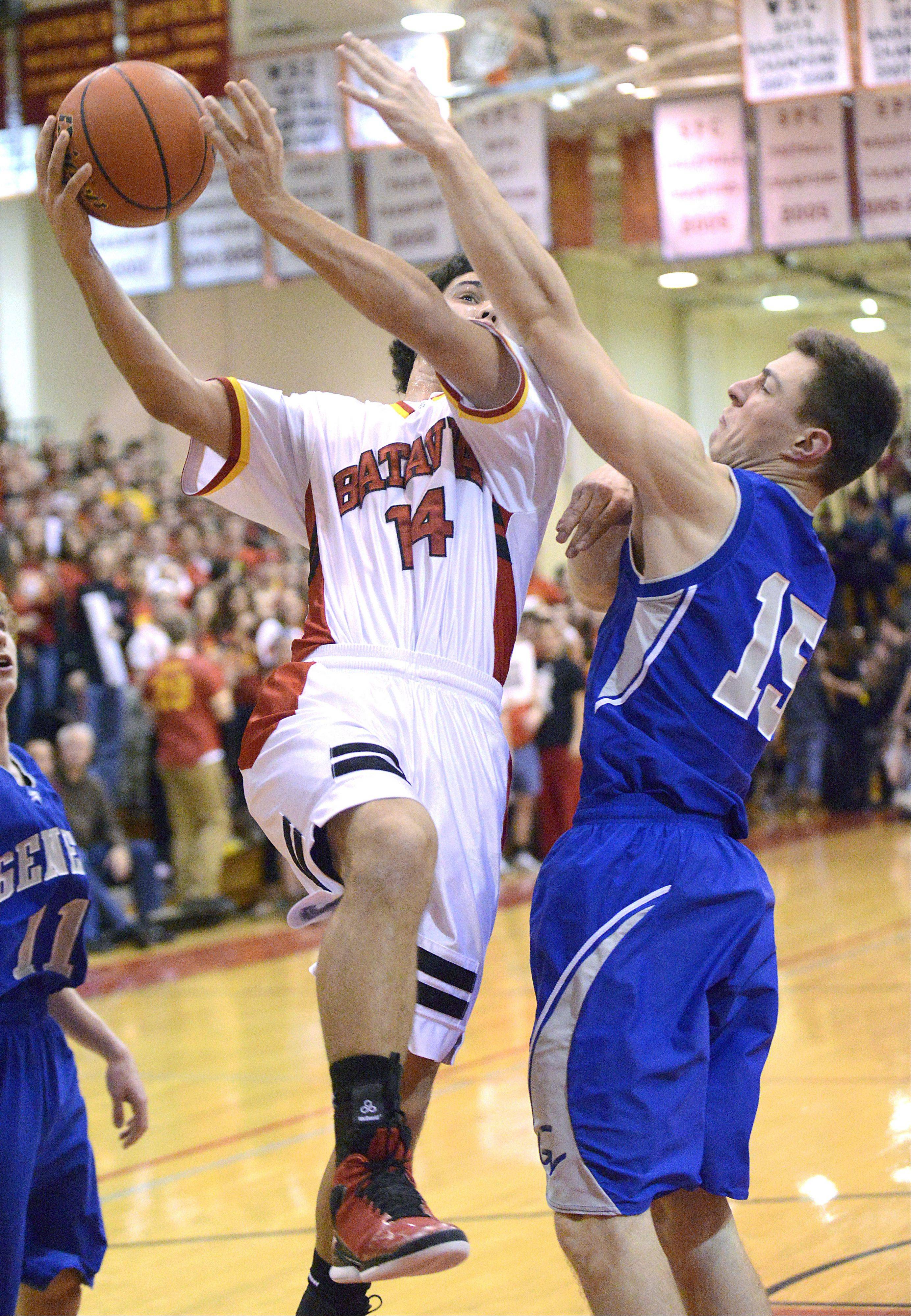 Geneva's Kyle Brown attempts to block a shot by Batavia's Micah Coffey in the second quarter on Friday, January 11.