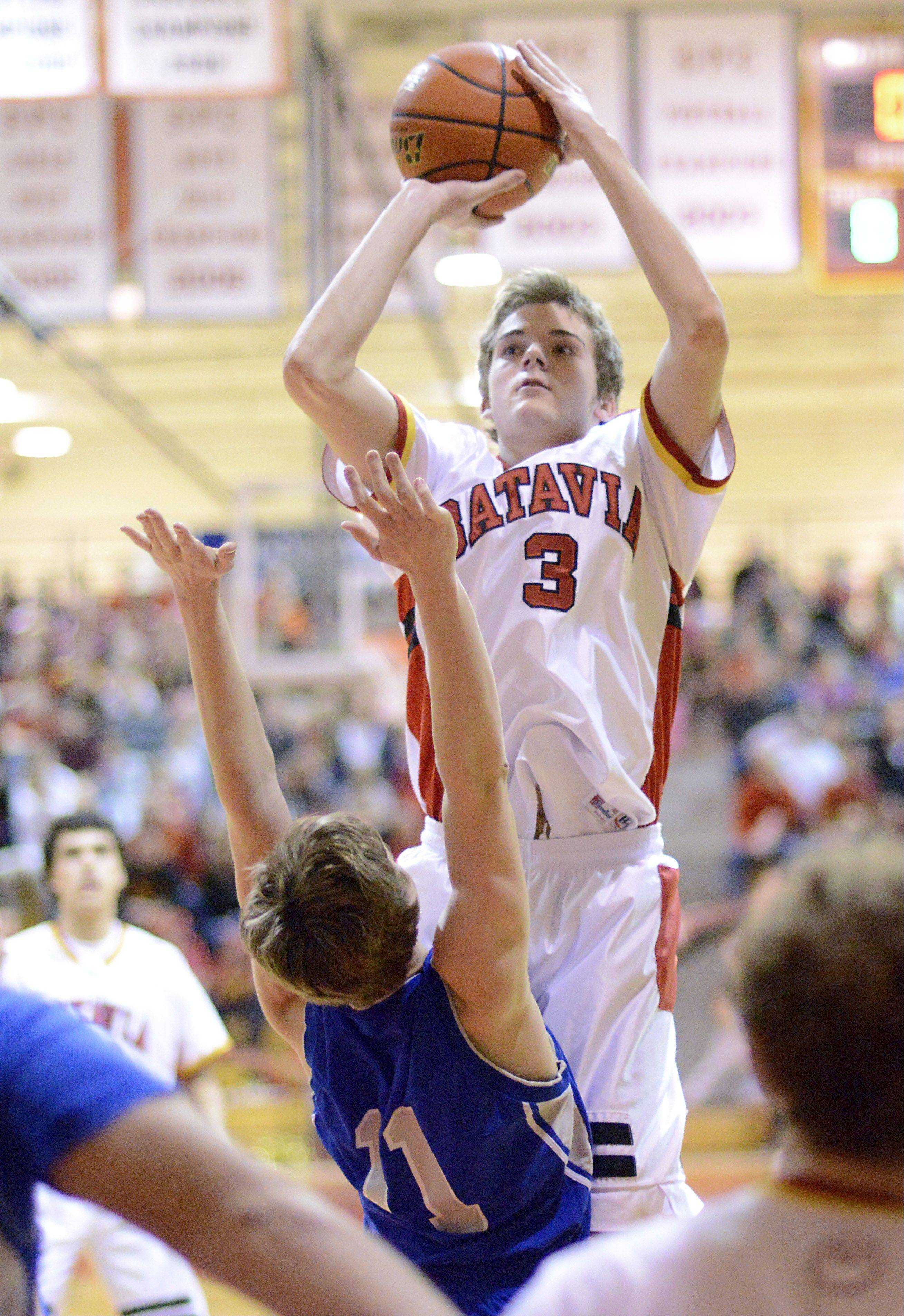 Geneva's Cam Cook can't block a shot by Batavia's Jake Pollack in the first quarter on Friday, January 11.