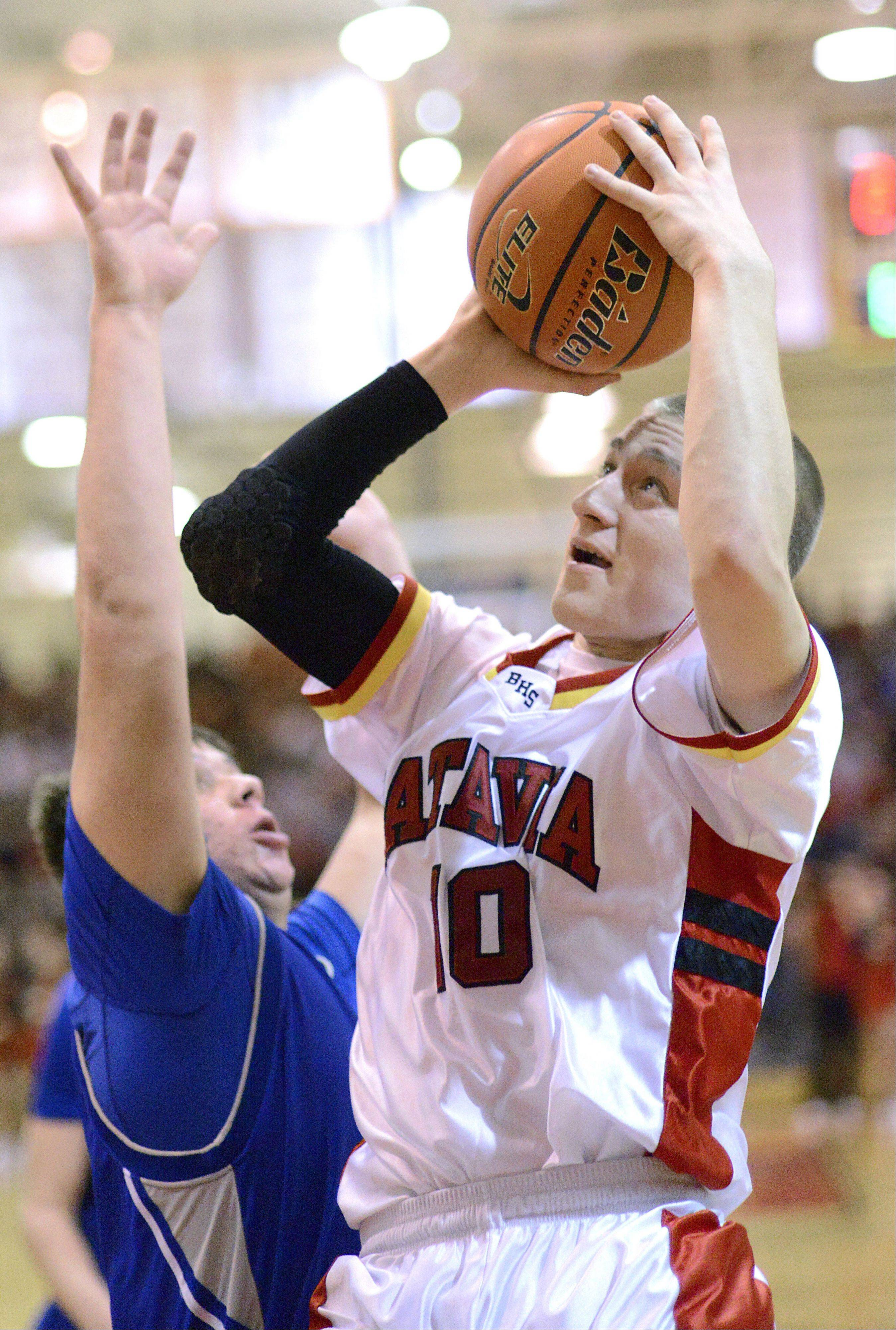 Batavia's Mike Rueffer shoots over a block by Geneva's Connor Chapman in the second quarter on Friday, January 11.
