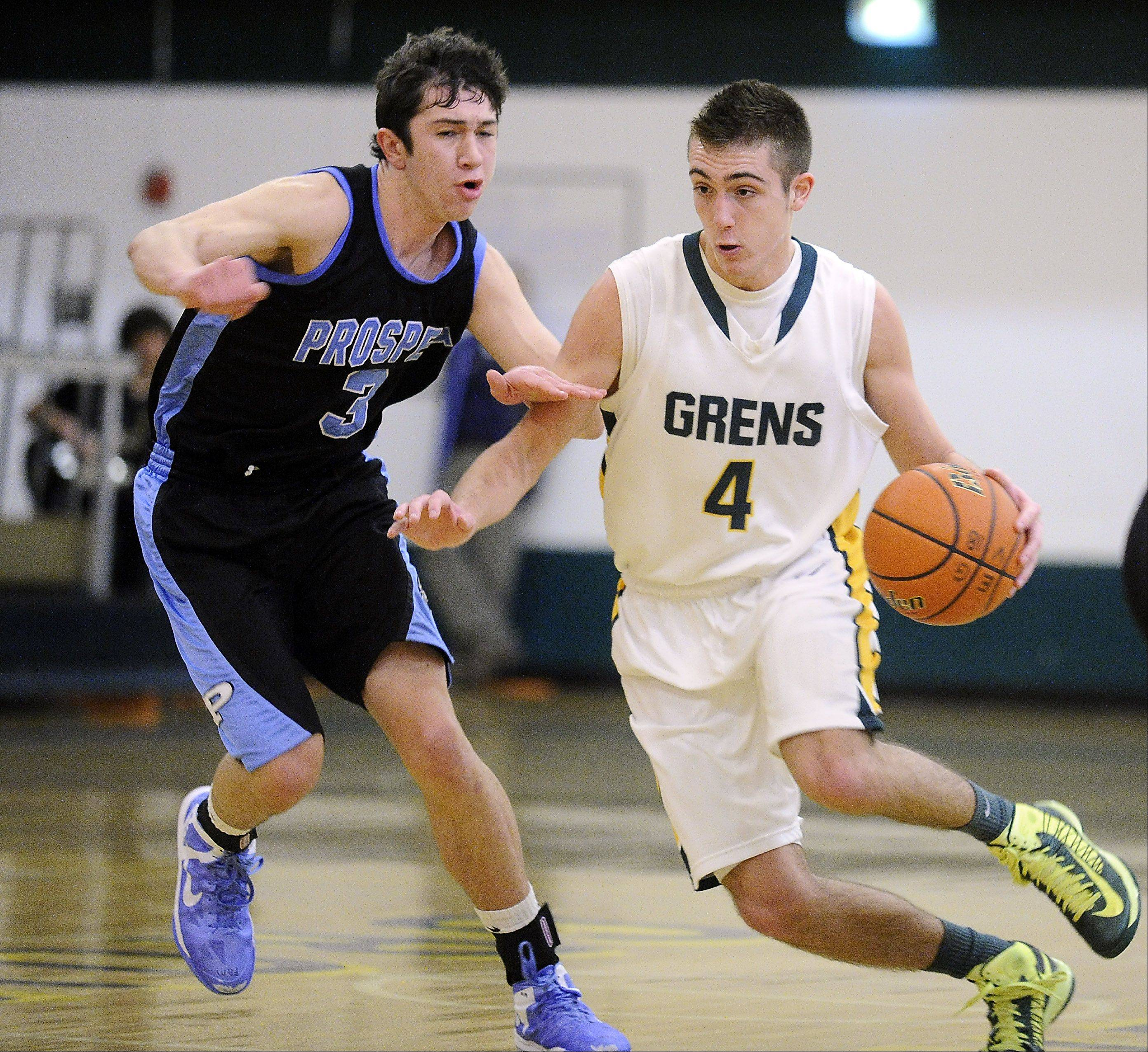 Elk Grove's Austin Amann tries to dribble-drive around Prospect's Bobby Frasco en route to the basket at Elk Grove.
