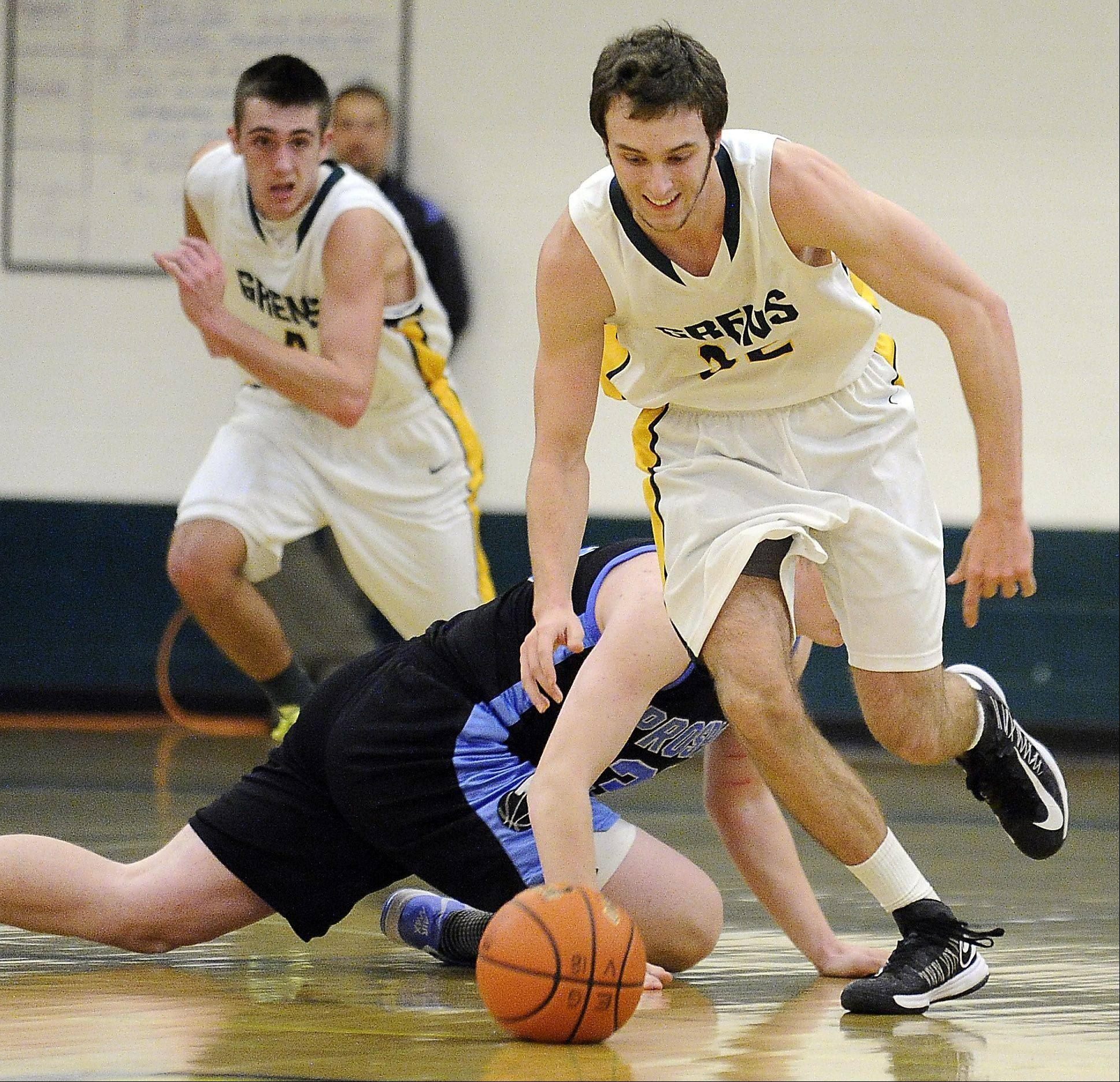 Elk Grove's Brian Kelly gets a steal as Prospect's Welby Malczewski defends, then starts toward the basket at Elk Grove on Friday.