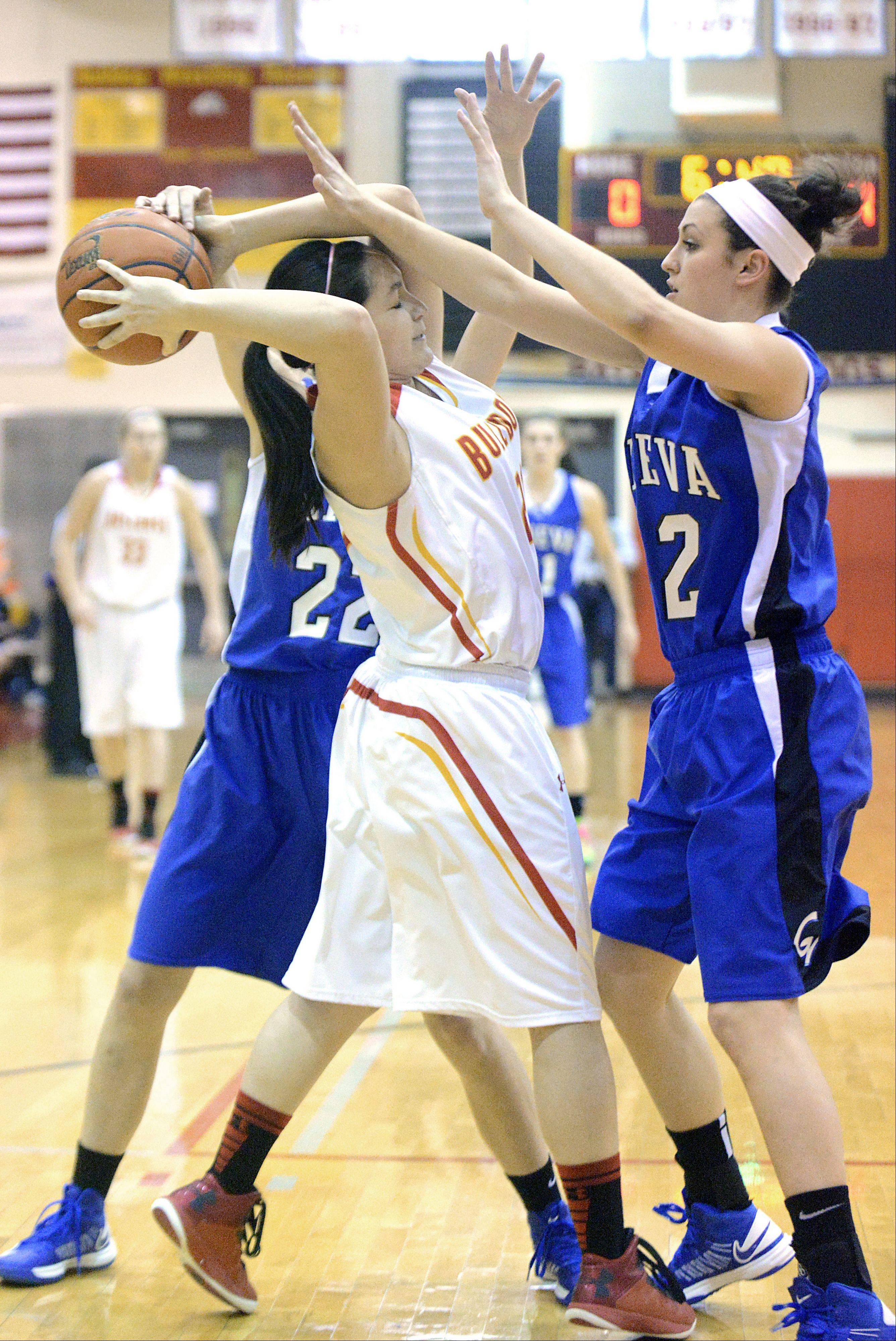 Geneva's Morgan Seberger and Abby Novak smother Batavia's Sami Villarreal after grabbing a Vikings rebound in the first quarter on Friday, January 11.