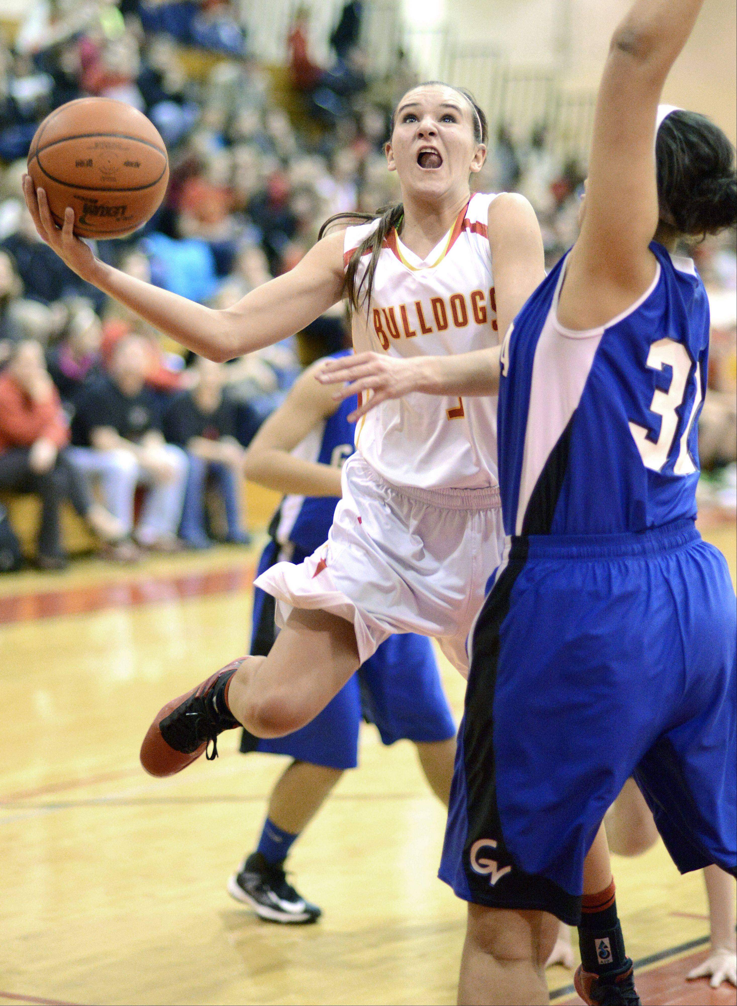 Geneva's Sidney Santos attempts to block a shot by Batavia's Liza Fruendt in the second quarter on Friday, January 11.