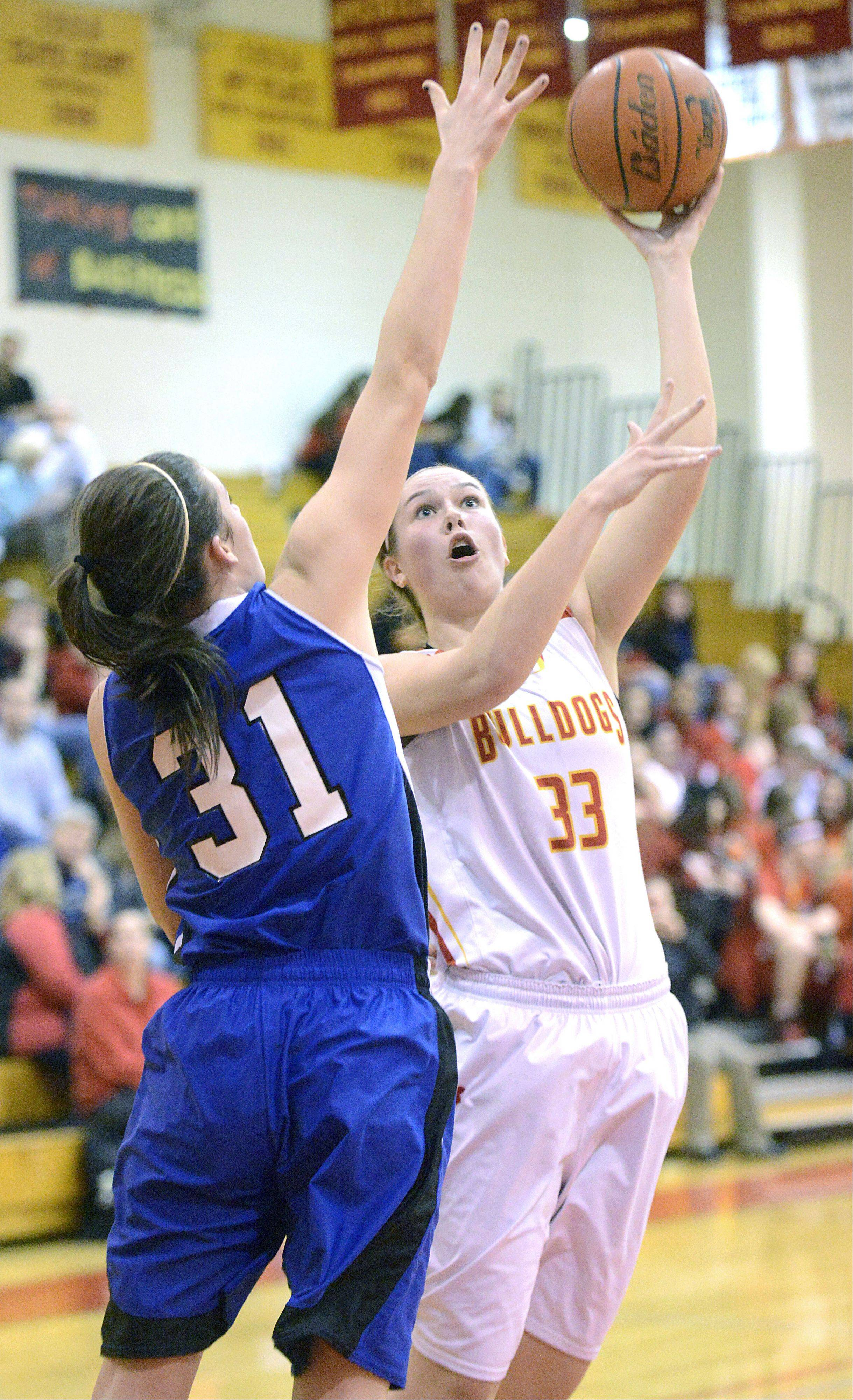 Geneva's Sami Pawlak attempts to block a shot by Batavia's Erin Bayram in the second quarter on Friday, January 11.