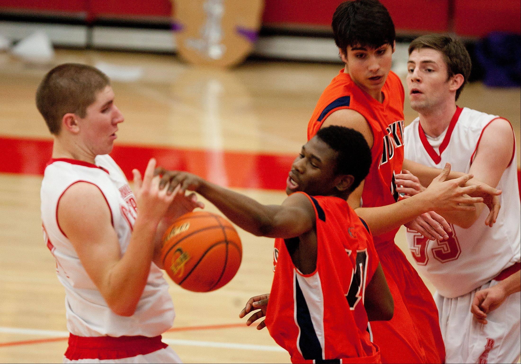 Naperville North's Jelani McClain Jr., center, fights for possession.