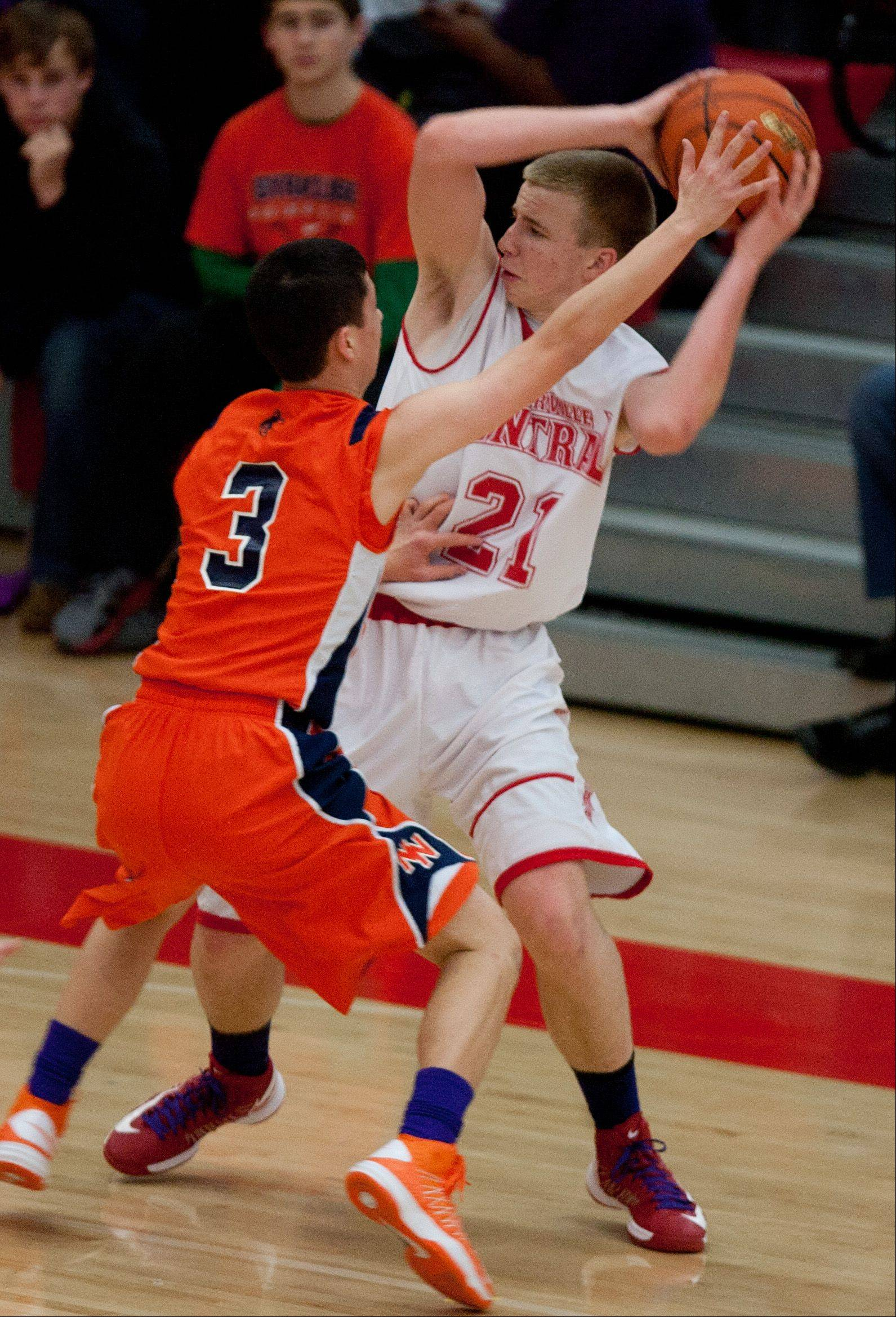 Naperville Central's Mike Blaszczyk looks to pass around Naperville North's Jayson Winick.