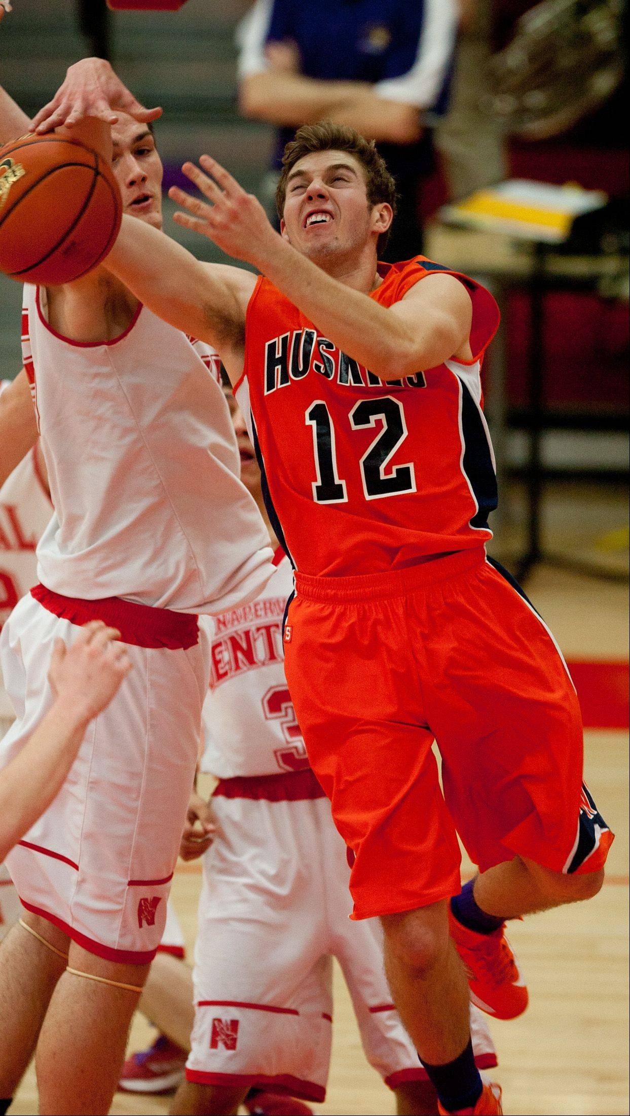 Naperville Central's Nick Czarnowski, left, defends Naperville North's Bryan LoLordo.