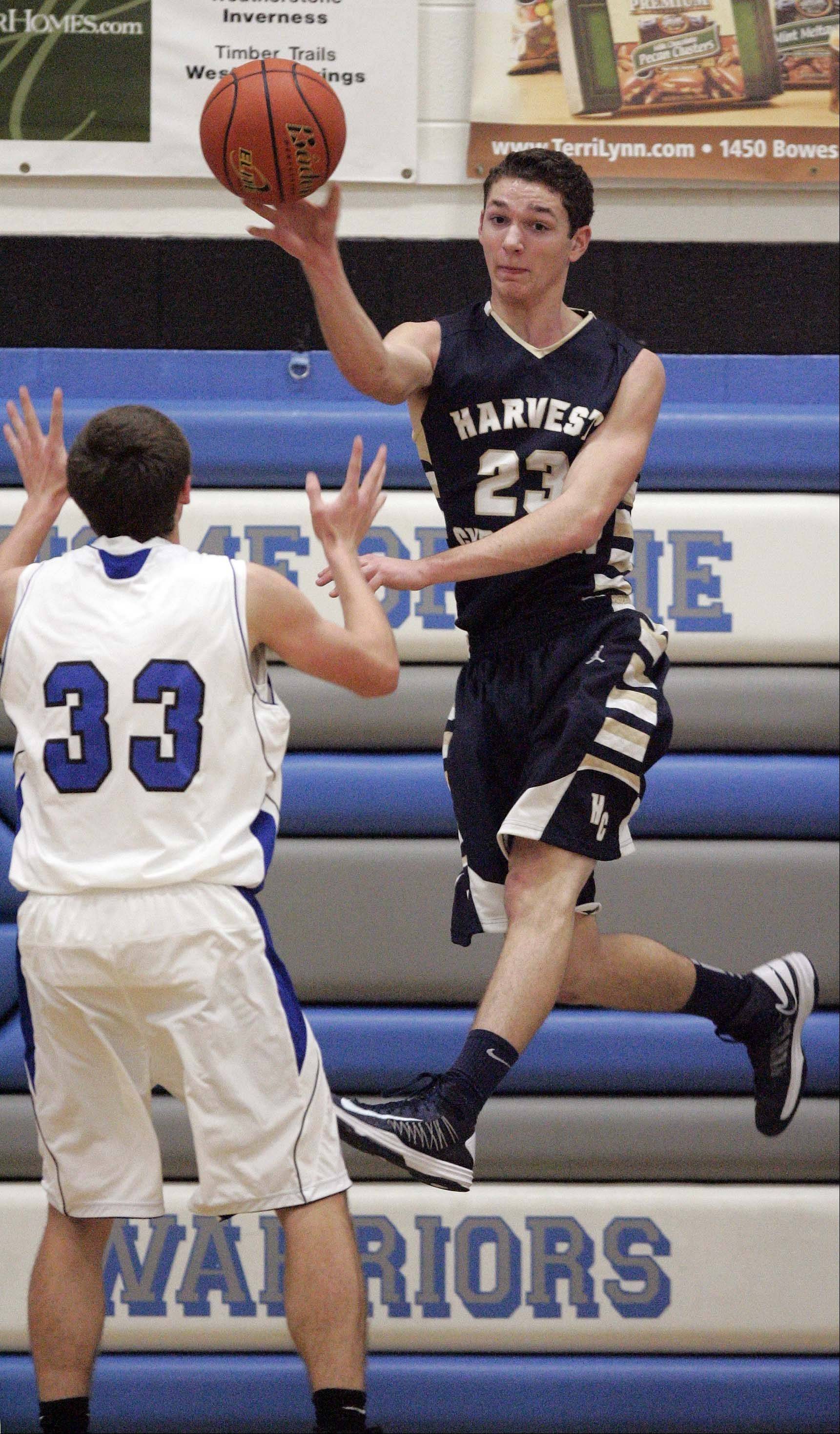 Harvest Christian's Stuart Wolff looks for an open teammate at Westminster Christian Friday night.