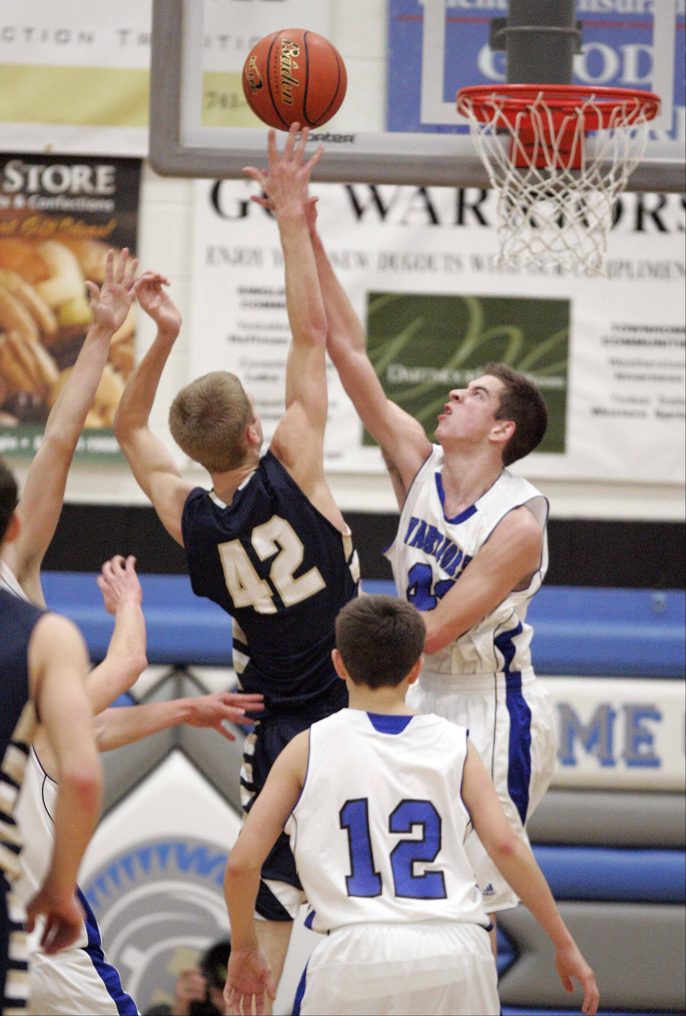 Westminster Christian guard Colin Brandon goes head-to-head with Harvest Christian center Dan Turpin .