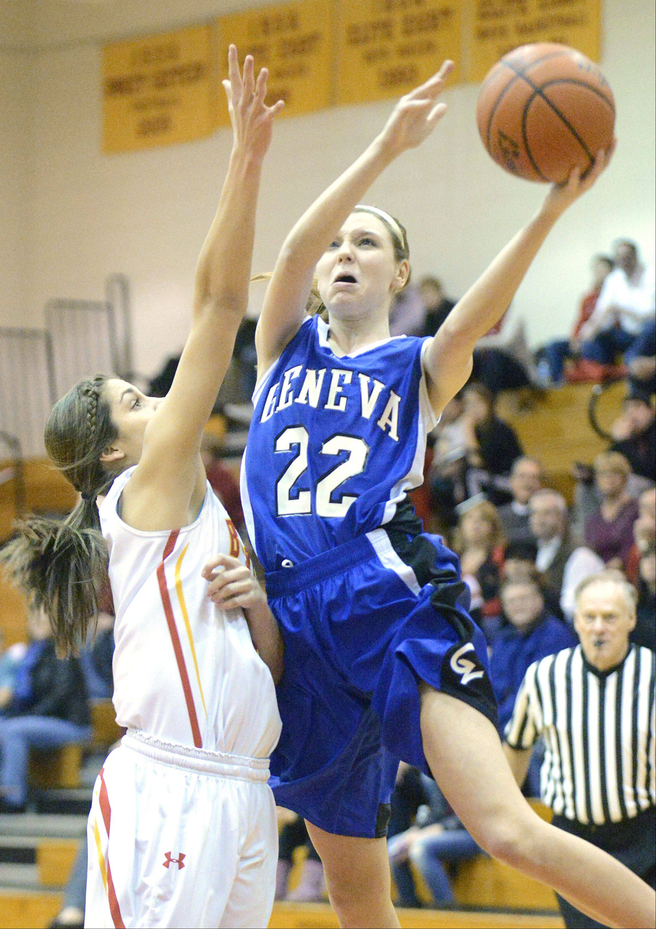 Geneva's Morgan Seberger takes a shot past a block by Batavia's Miranda Grizaffi in the first quarter.