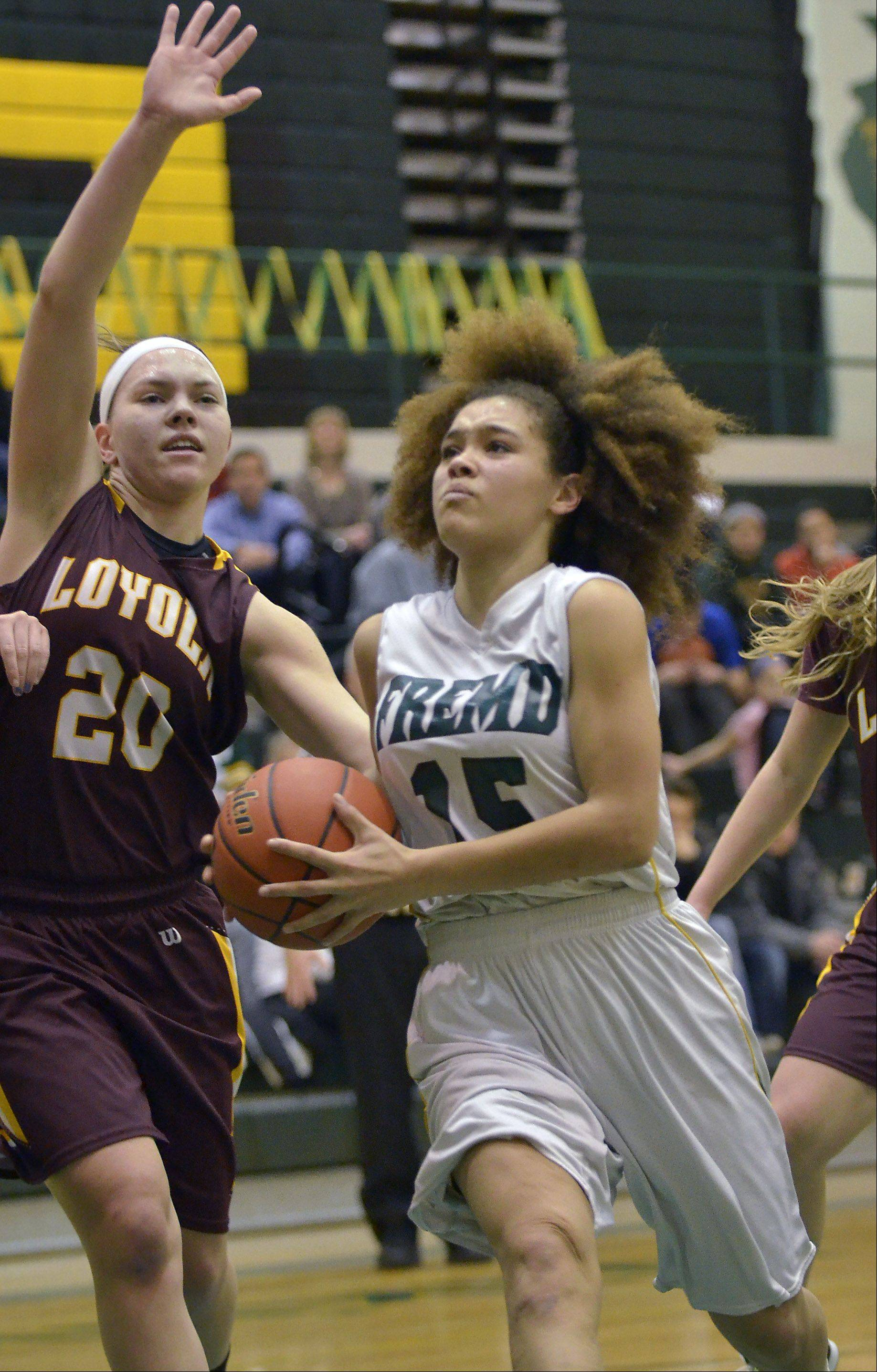 Fremd's Bernie Williams puts up a shot against Loyola's Egan Berne .