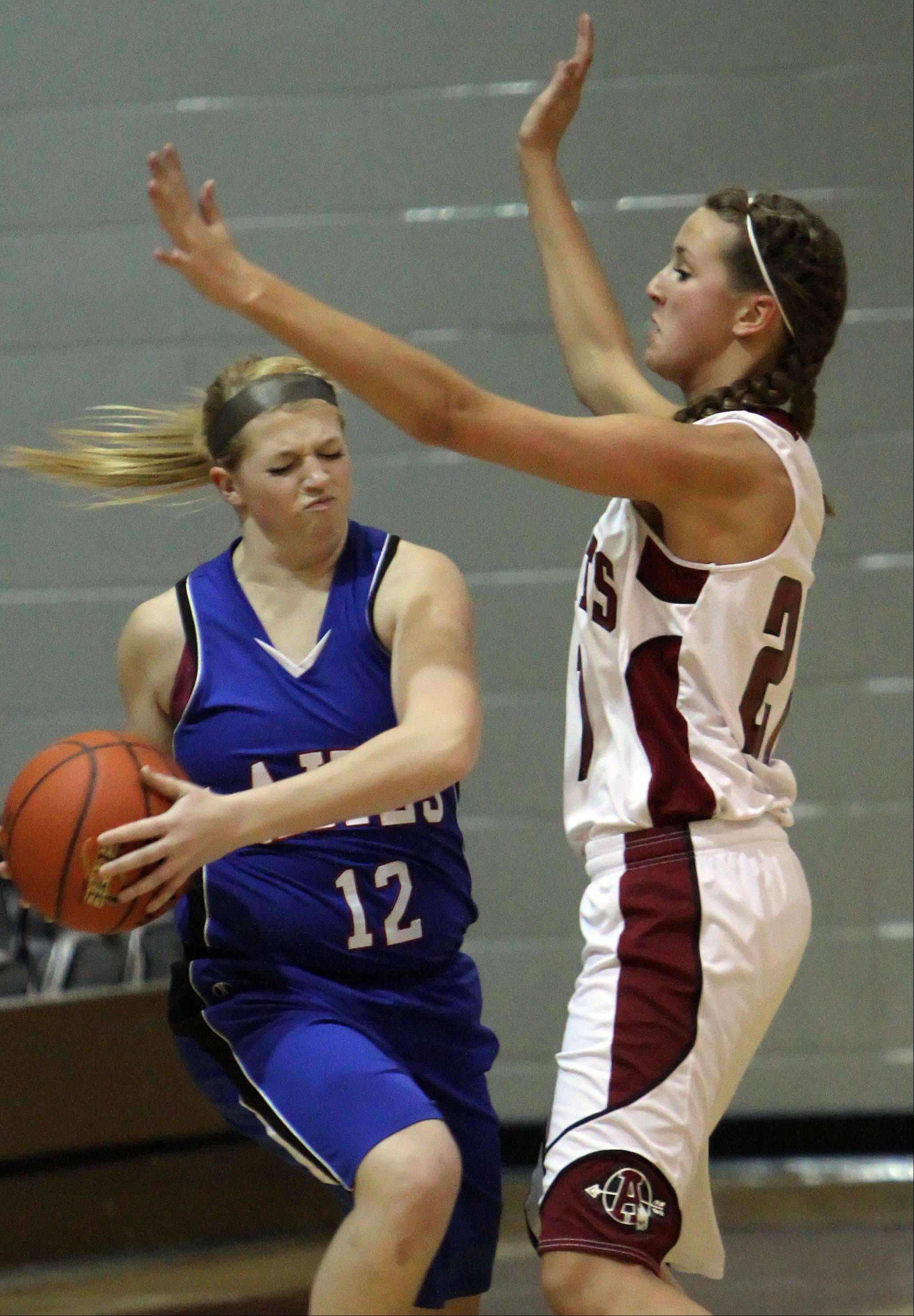 Lakes' Dayna Olson, left, tries to get around Antioch's Carly McCameron on Tuesday night at Antioch.