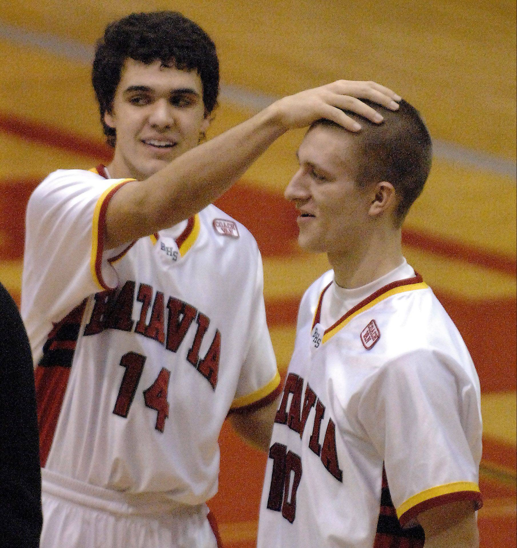 Above: Batavia's Mike Rueffer (10) gets a congratulatory pat on the head from teammate Micah Coffey after scoring the winning basket with 7 seconds left against Elgin Tuesday at Batavia. Below: Rueffer knocks a away a last second alley-oop attempt by Elgin to seal the 55-54 win.