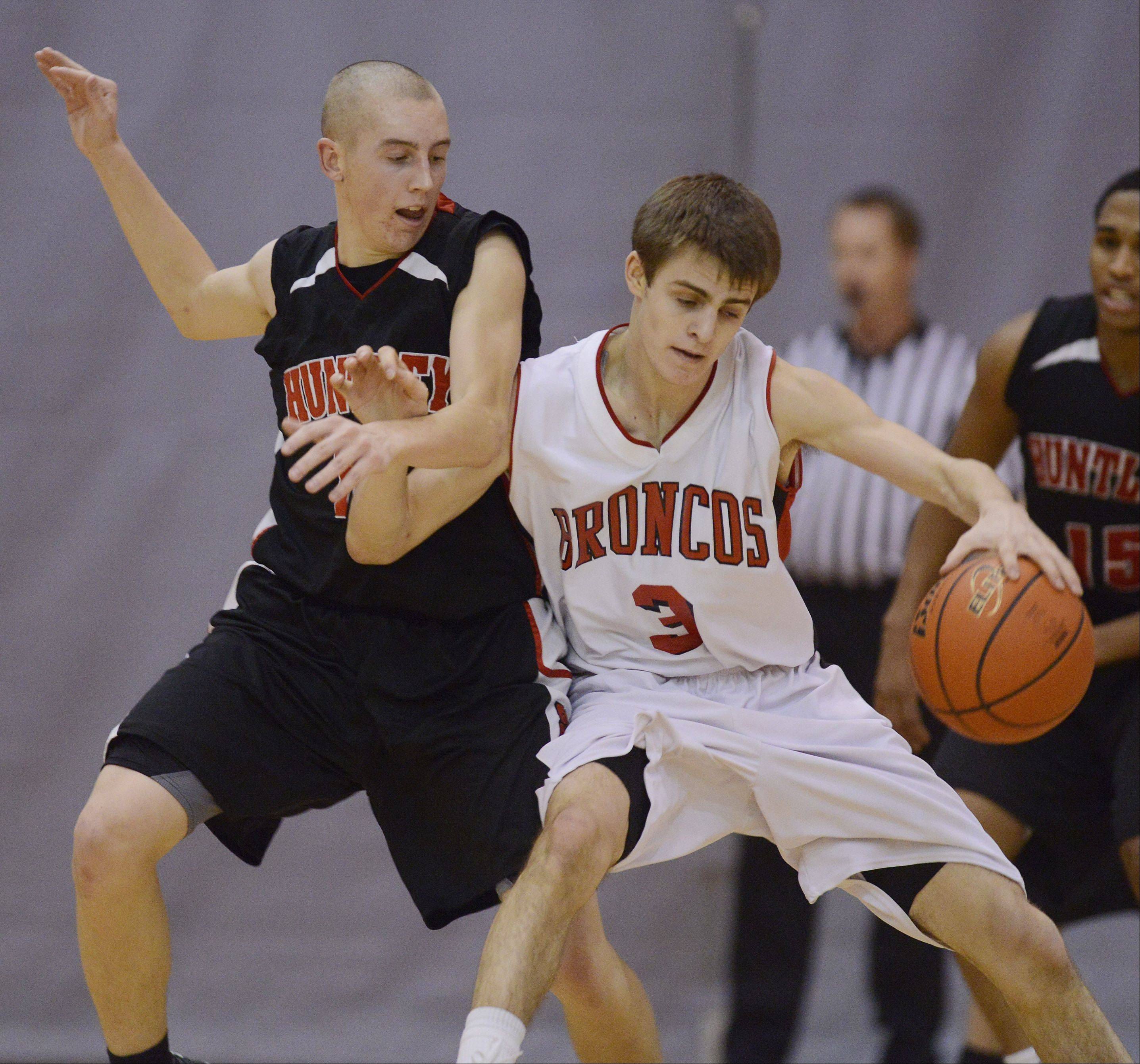 Huntley's TJ Adams makes contact with Barrington's Brad Zaumseil.
