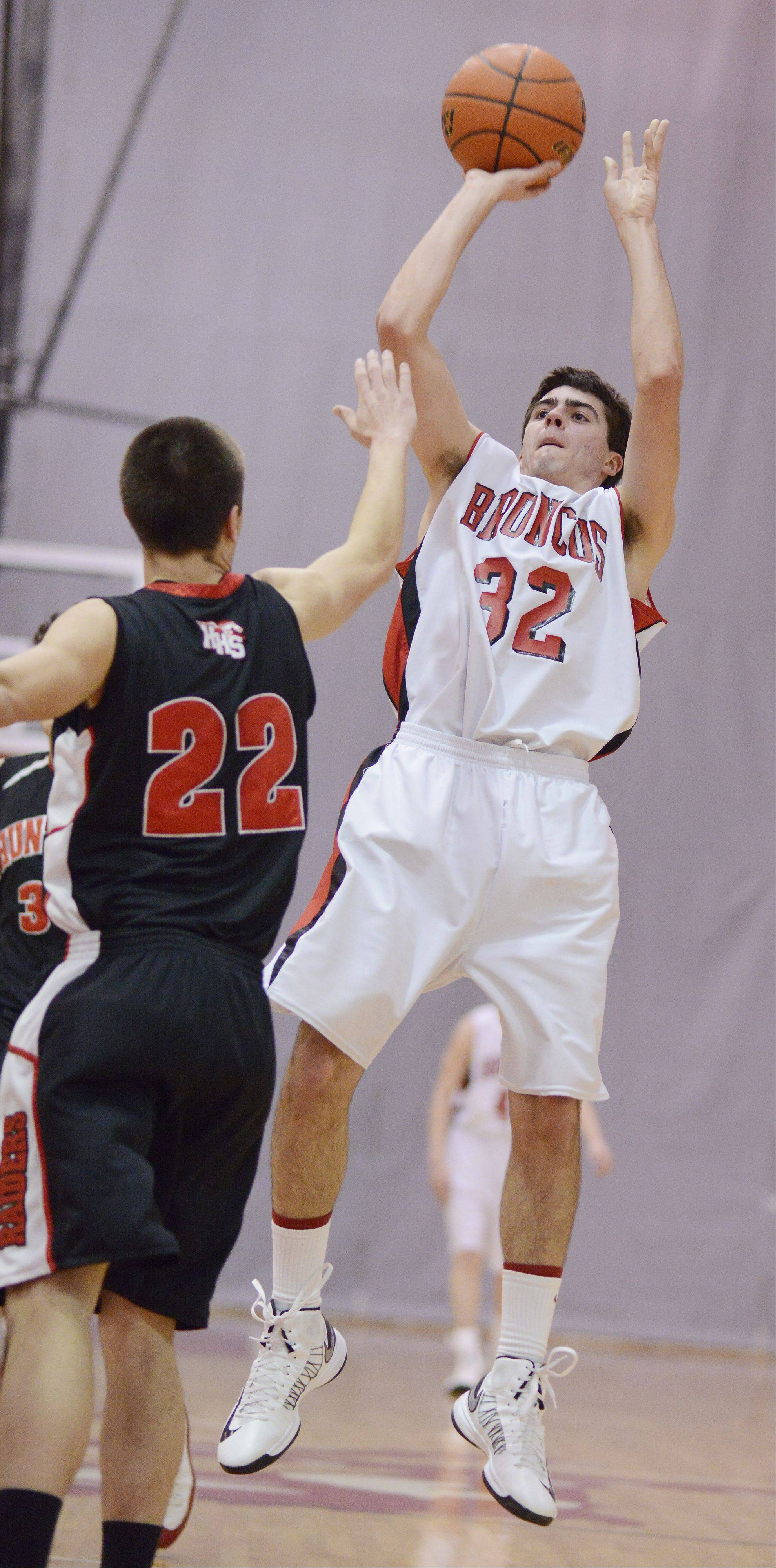Barrington's Austin Madrzyk takes a shot as Huntley's Jake Wagner tries to get a hand up on defense.