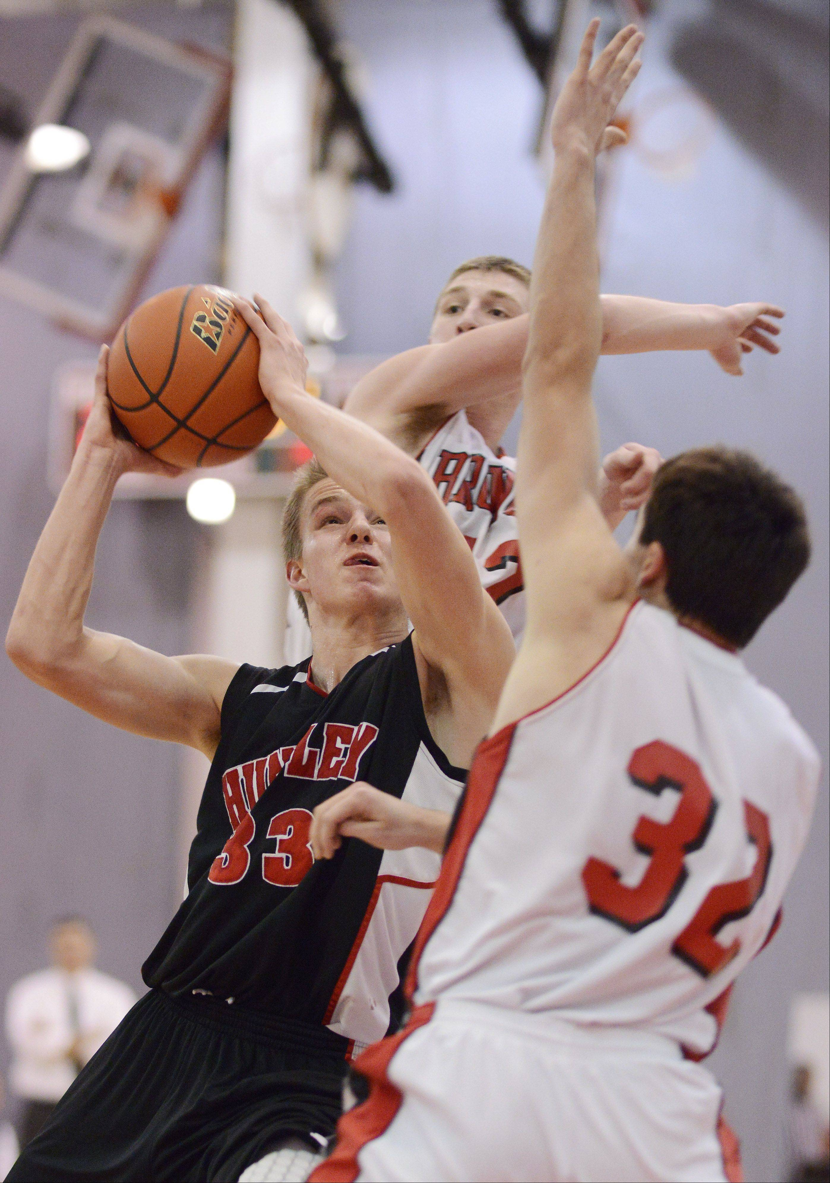 Huntley's Zach Gorney attempts a shot against the defense of Barrington's Austin Madrzyk, front, and Robby Vollman during Tuesday's game.
