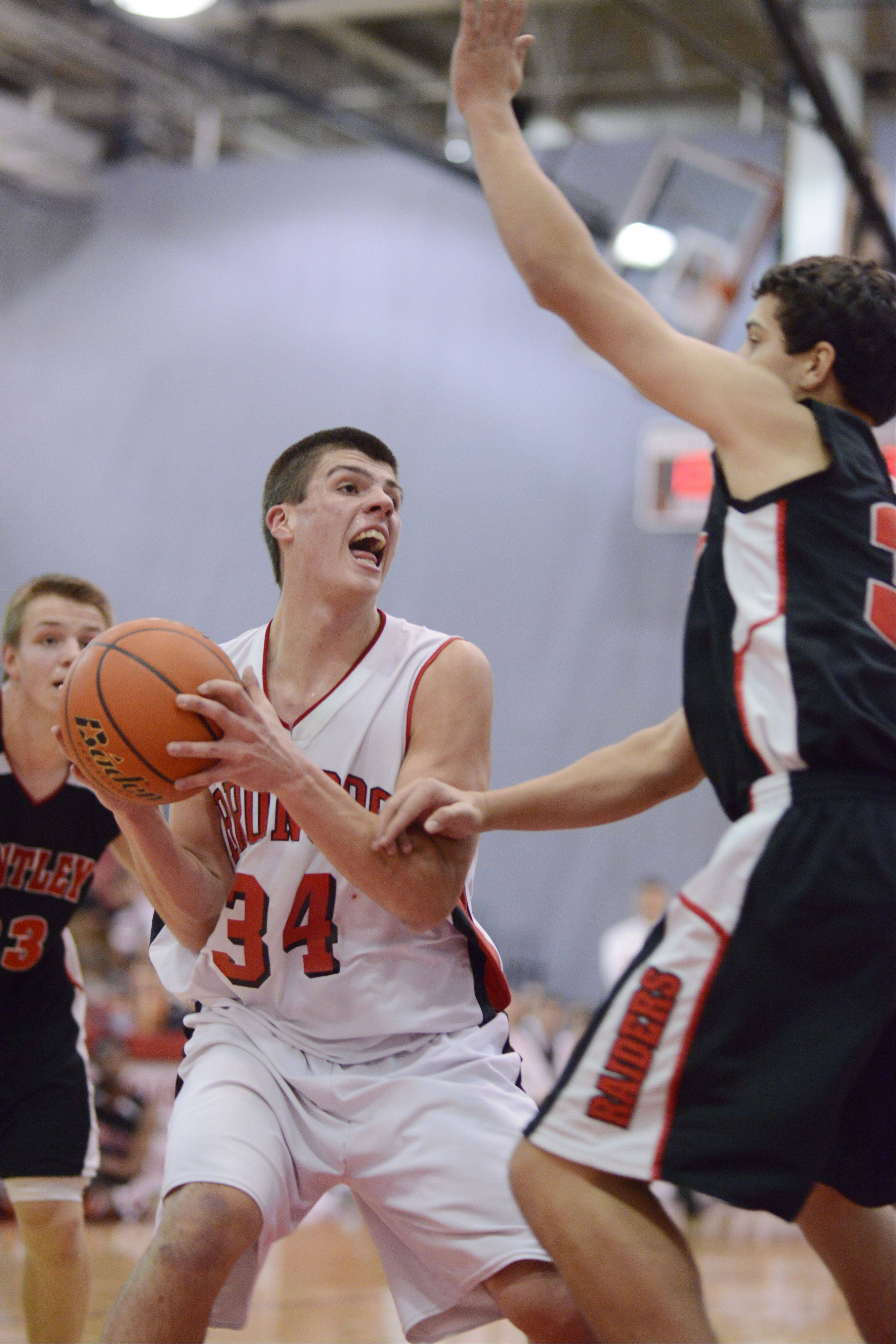 Barrington's Zach Bart makes a strong move to the basket against Huntley's Riley Wicks.