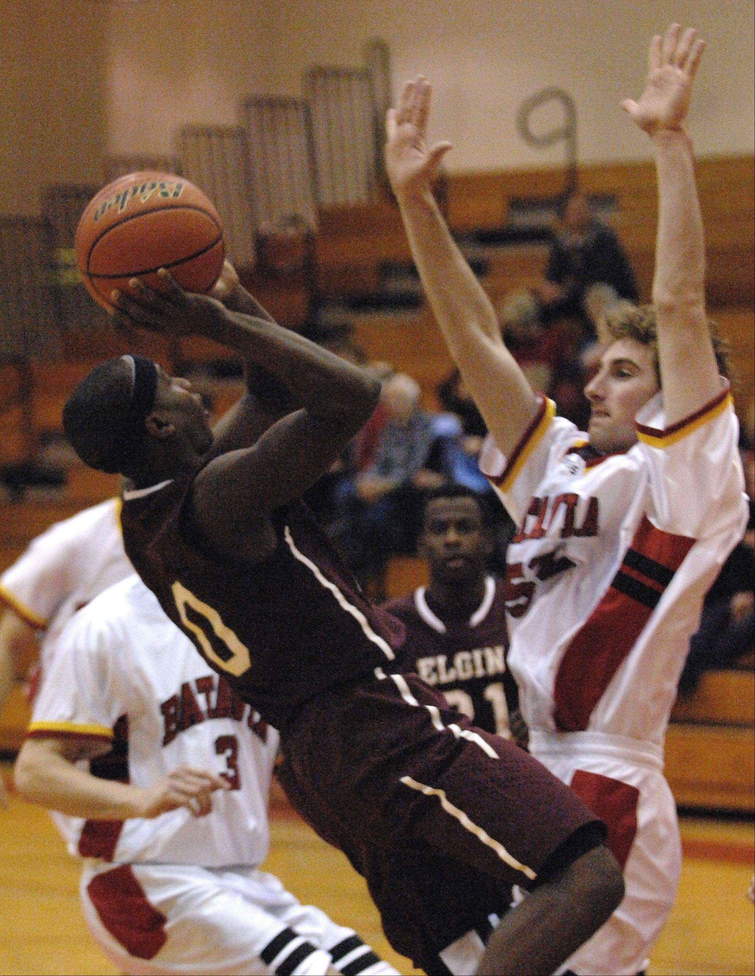 Elgin's Arie Williams scores on a fade-away jumper over Batavia's Like Horton.