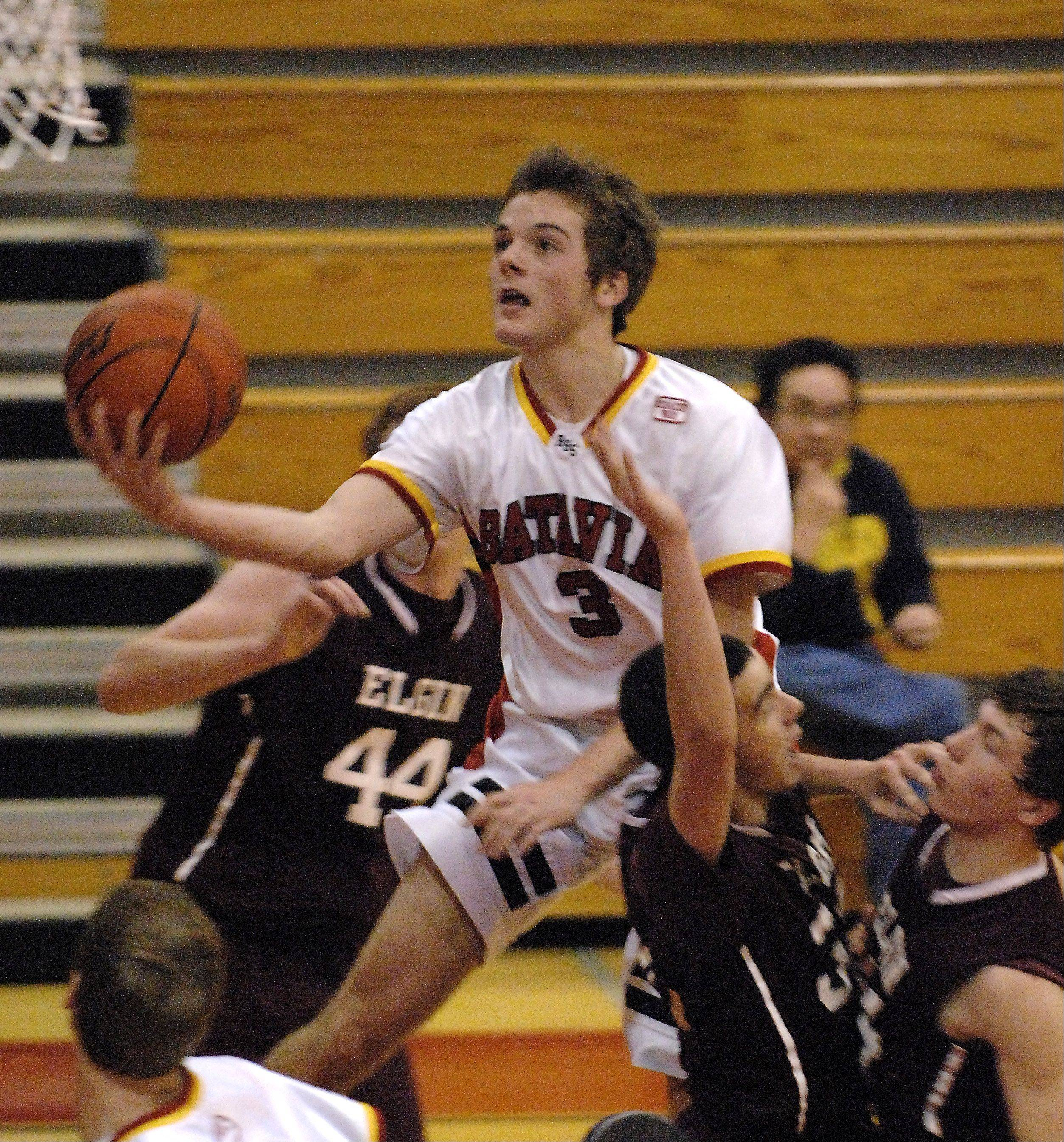 Batavia's Jake Pollack drives through the lane and scores against Elgin .