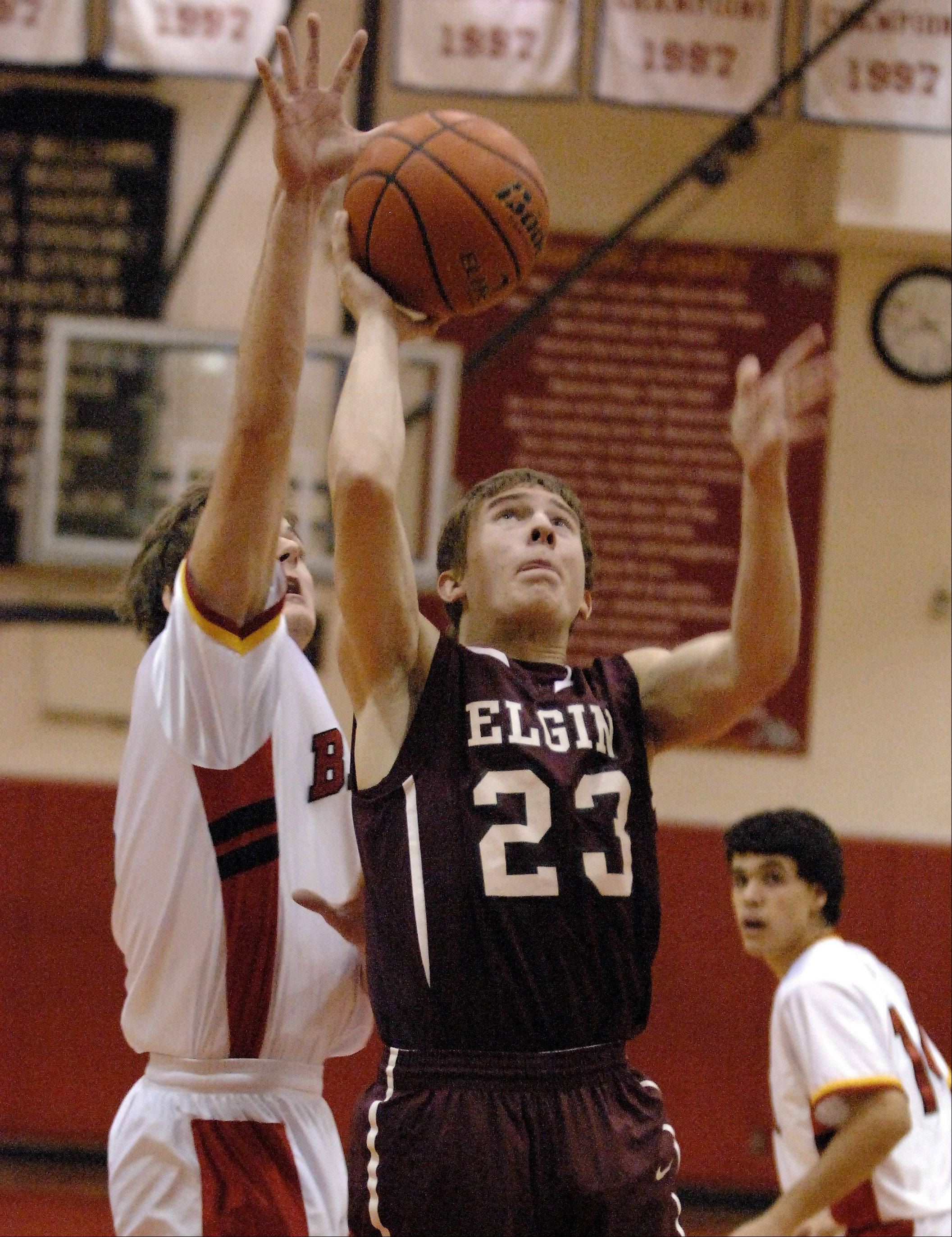 Batavia's Jake Pollack blocks a shot by Elgin's Tanner Bednar.